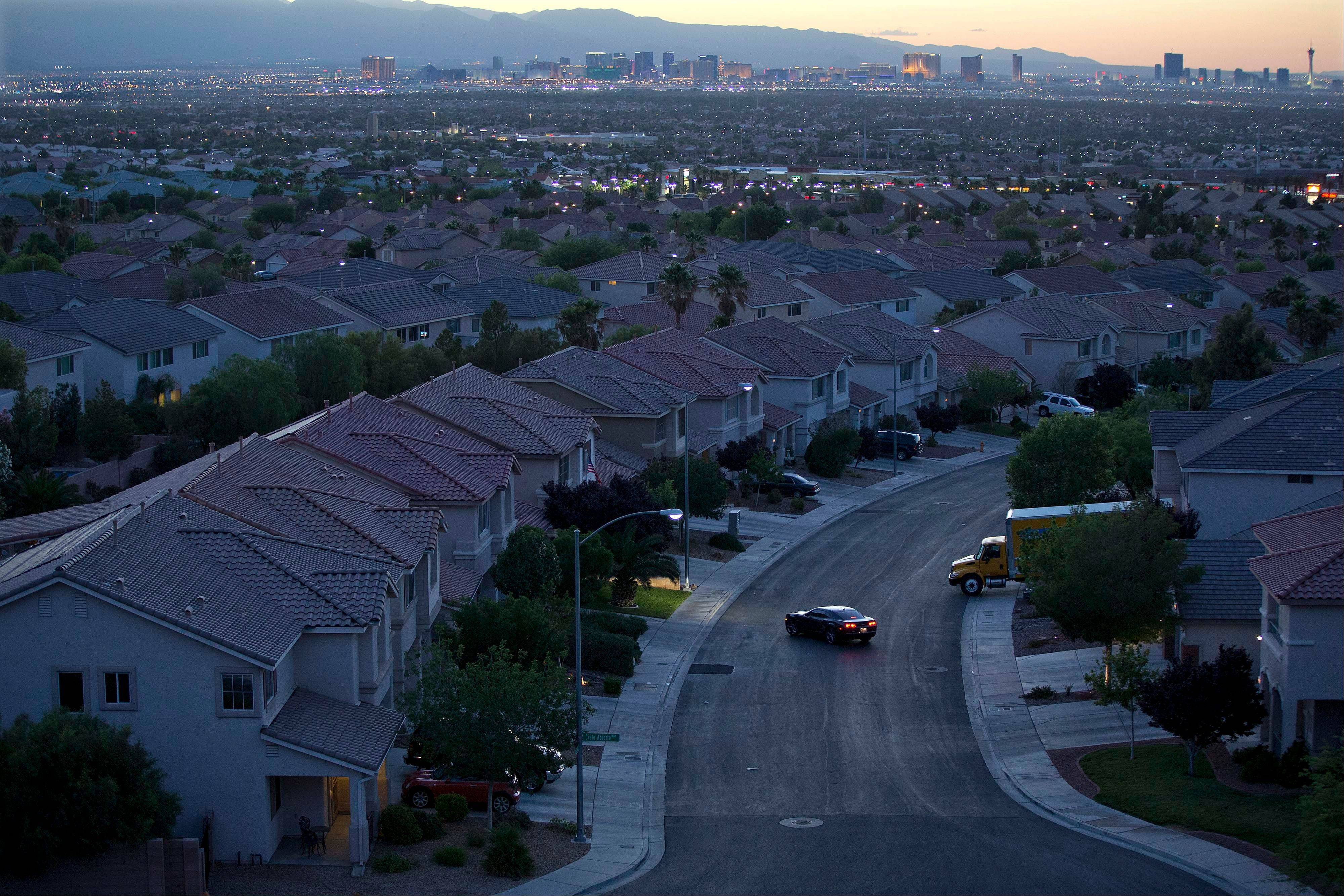A motorist pulls into the driveway in a neighborhood in Henderson, Nev. U.S. mortgage rates declined this week, with the average on the 30-year fixed loan remaining just under 4 percent. But rates likely will surge next week now that Chairman Ben Bernanke said the Federal Reserve is likely to reduce its bond purchases later this year.