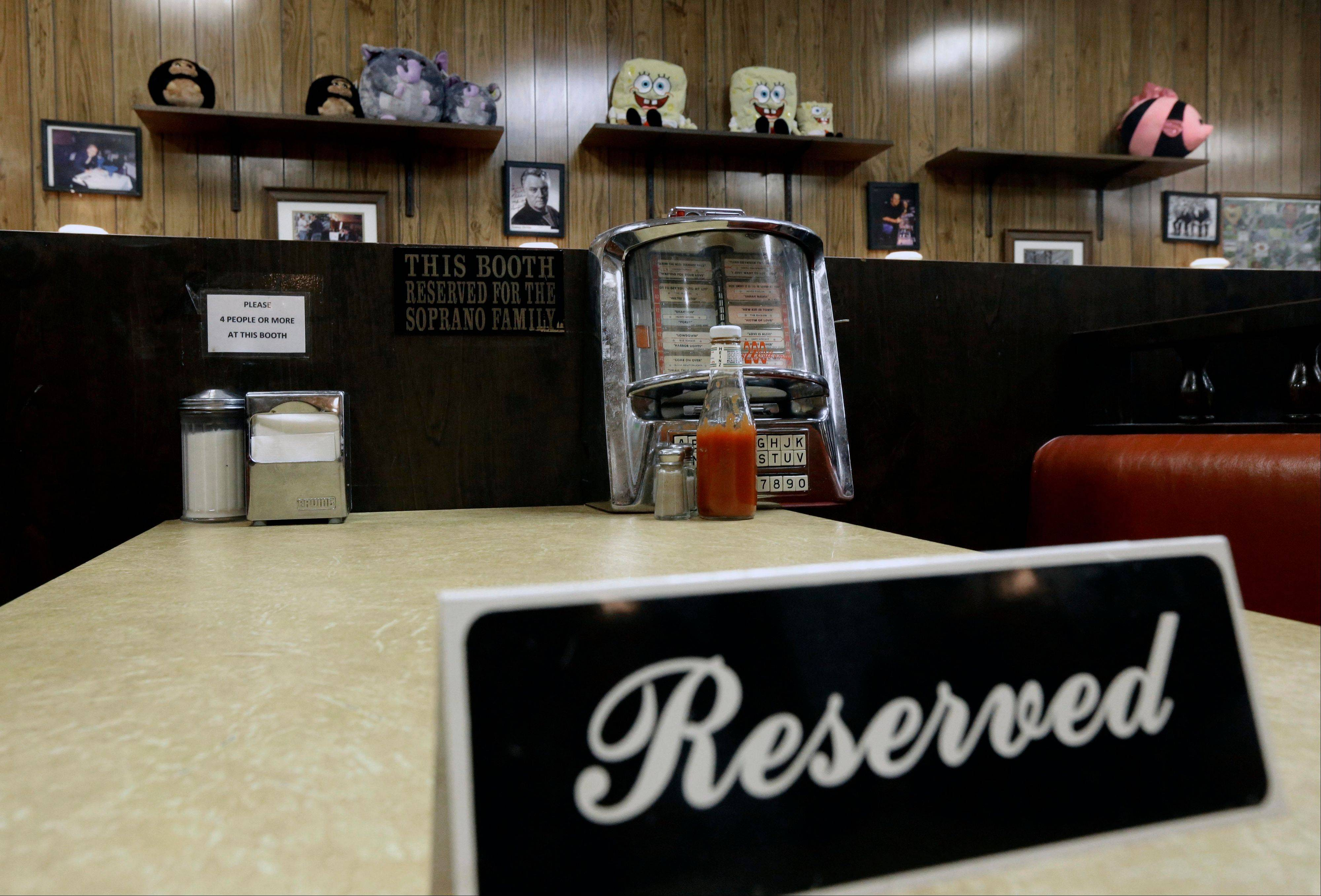 "A reserved sign sits on the booth where the last show of the HBO series ""The Sopranos"" was filmed at Holsten's ice cream parlor, Wednesday, June 19, 2013, in Bloomfield, N.J. The sign was put on the booth where the last scene was filmed in honor of actor James Gandolfini who died Wednesday in Italy. He was 51."