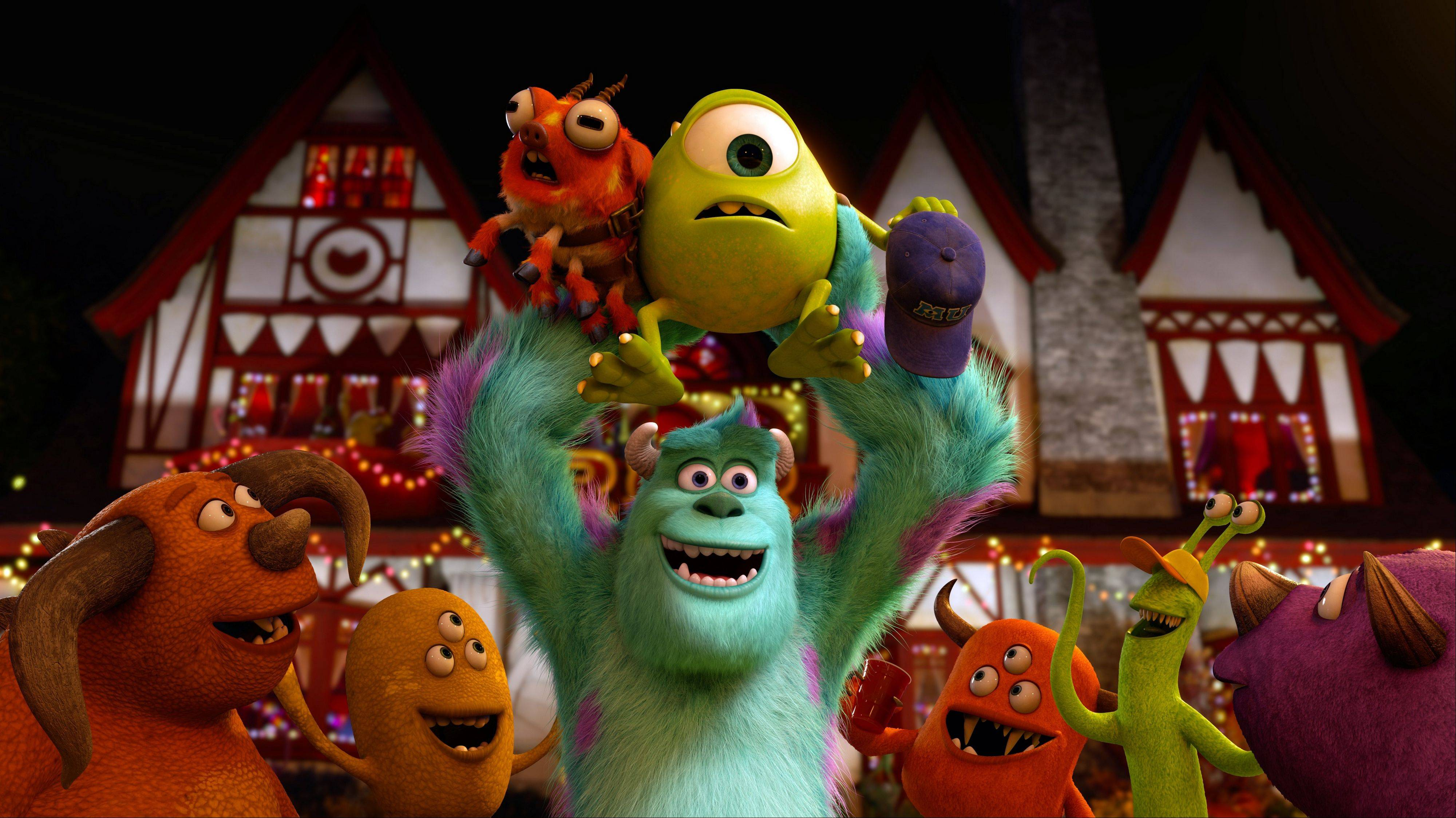 "In Pixar's ""Monsters University,"" Sully (John Goodman) triumphantly hoists one-eyed Mike (Billy Crystal) during the Scare Games contest."