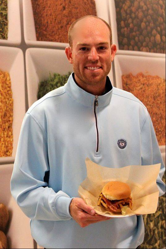 Robbie Gould shows off his Goulden Burger, now available at Meatheads. A portion of the proceeds will benefit his charity.