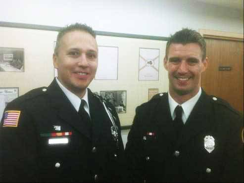 Buffalo Grove firefighters William Navarro, left, and Daniel Pasquarella were honored for their bravery in going into a chemical tank to recover the body of a man who had died.