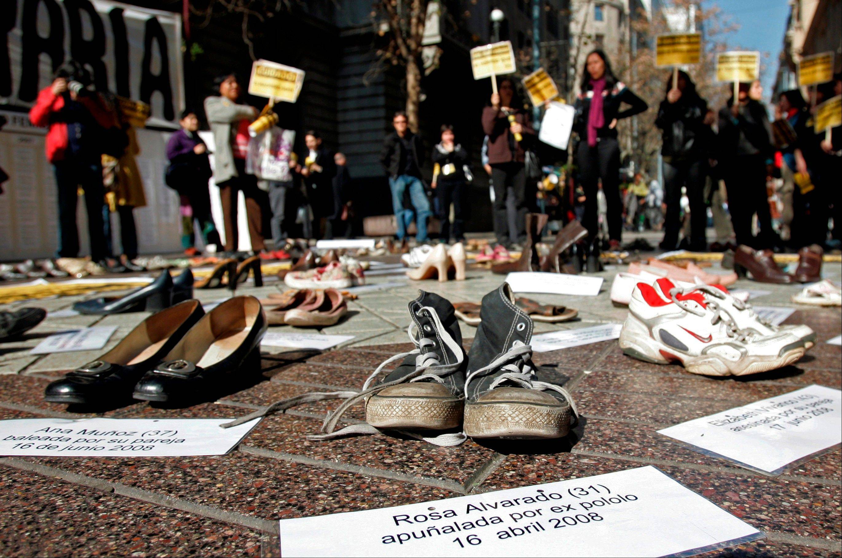 Shoes representing female victims of violence are displayed by protesters from the Chilean Network Against Domestic and Sexual Violence in Santiago. In a series of papers released on Thursday June 20, 2013, by the World Health Organization and others, experts estimated nearly 40 percent of women killed worldwide were slain by an intimate partner and that being assaulted by a partner was the most common kind of violence experienced by women.