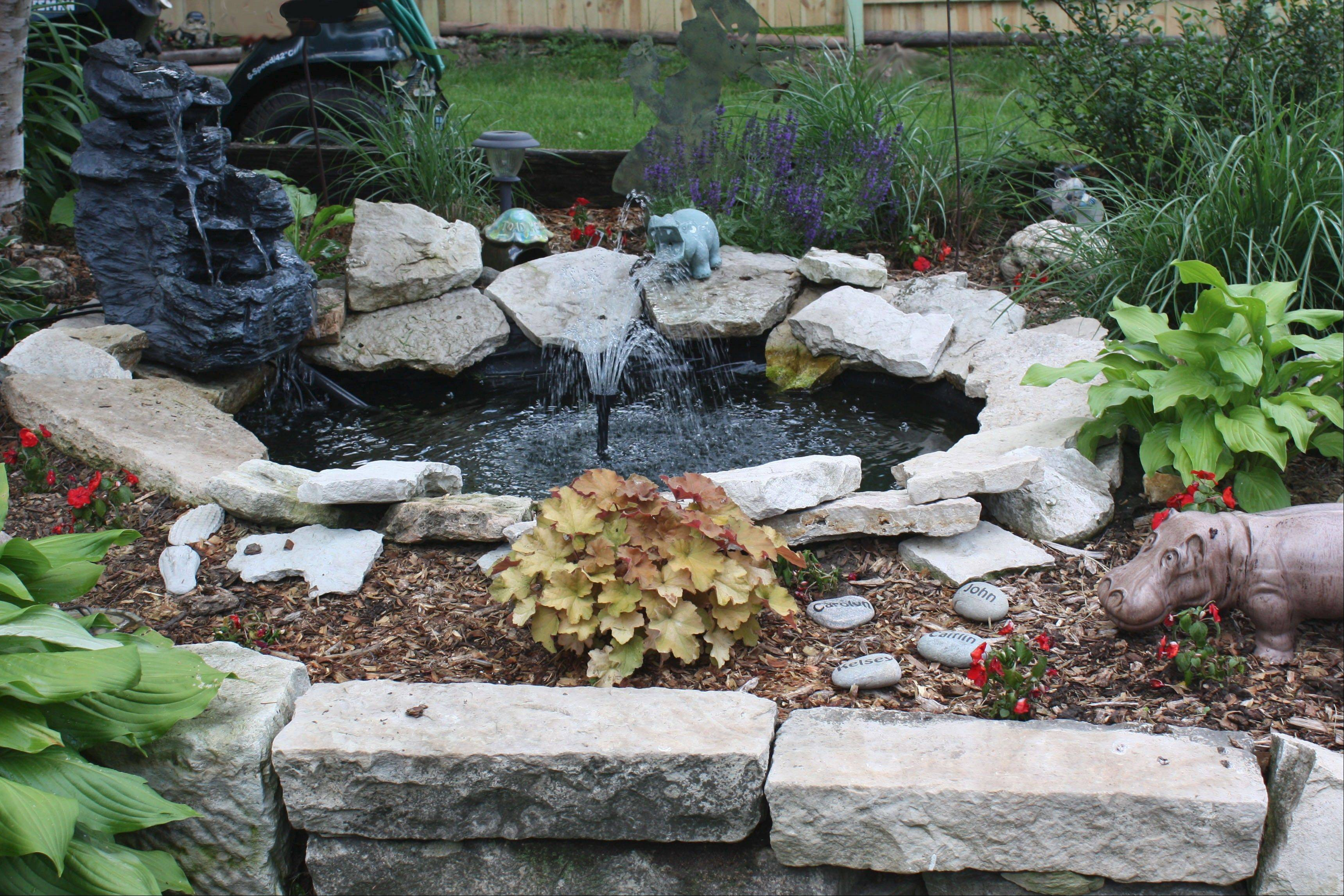 The Kanthack garden is a family affair with the couple and Carolyn's mother all pitching in their talents. The pond's tranquillity belies all the couple's work that went into creating it out of a hard clay soil.