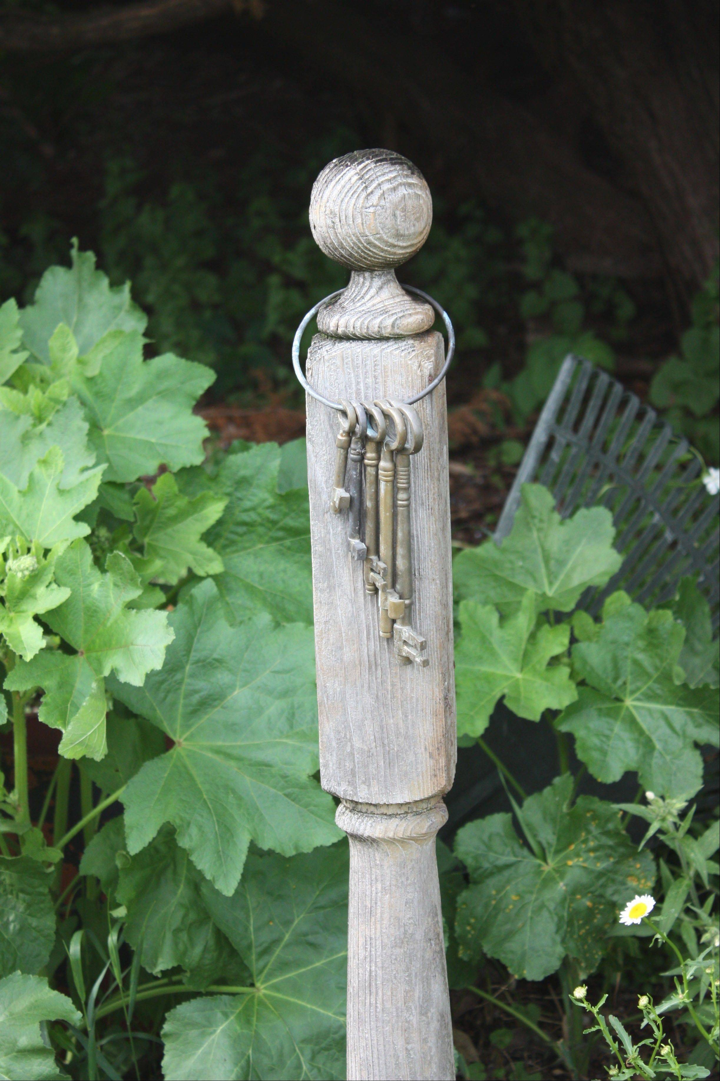 With a theme of reuse, recycle and re-purpose, a collection of old keys hitched to a single fence post always unlocks smiles of recognition to visitors to the Buehler garden.