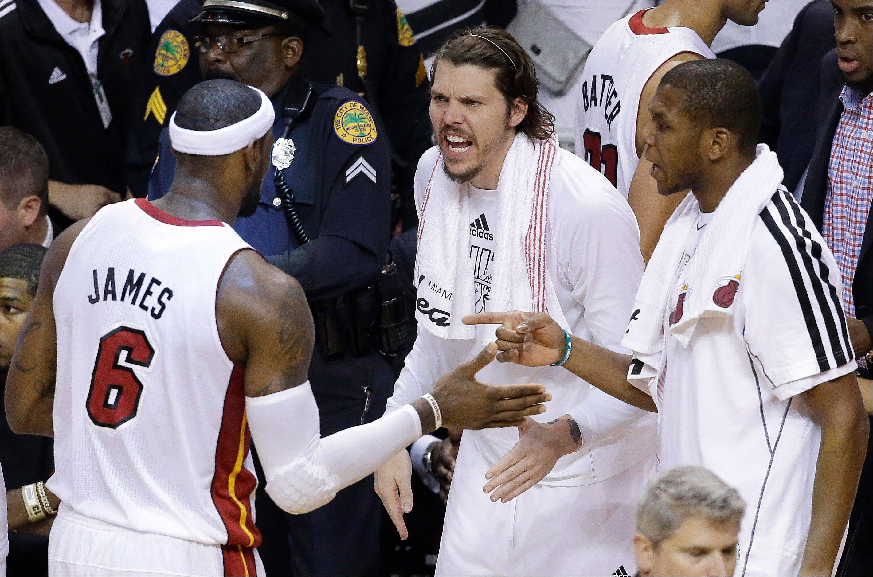 The Miami Heat's LeBron James speaks with teammates in the closing moments of the second half in Game 7 Thursday.