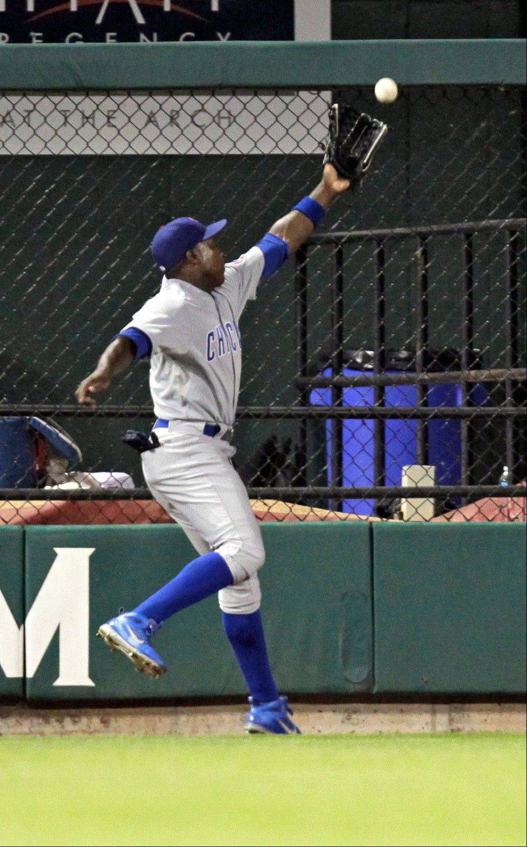 Cubs left fielder Alfonso Soriano misses a ball hit by the Cardinals' Yadier Molina in the sixth inning Thursday in St. Louis.