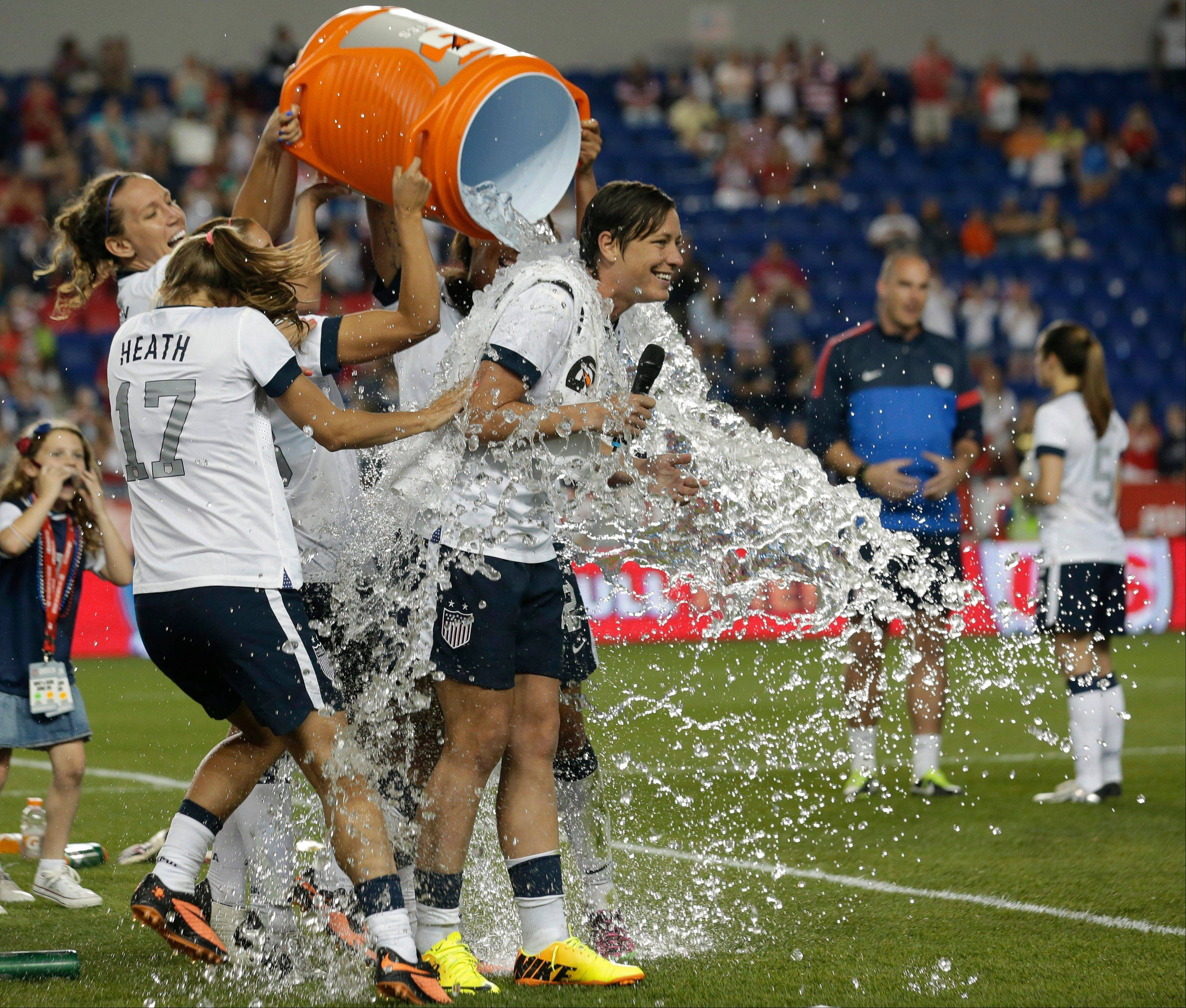 Abby Wambach is showered by teammates after a friendly match against South Korea at Red Bull Arena Thursday in Harrison, N.J. Wambach is now the greatest goal scorer in international soccer.