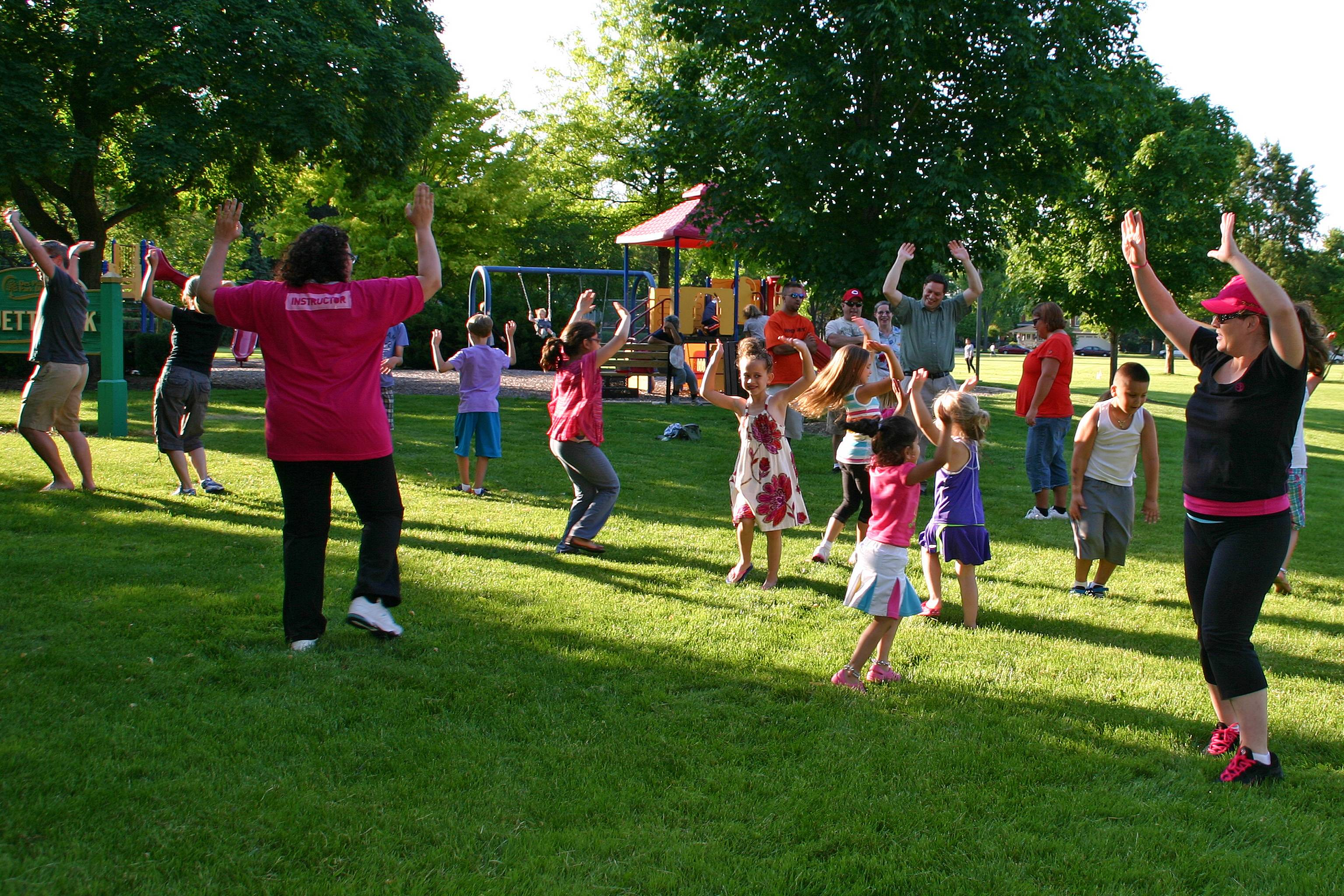 "Lisa Carbello, far right, teaches the neighborhood how to ""Zumba"" at the June 19 Park It! Patrol at Bluett Park."