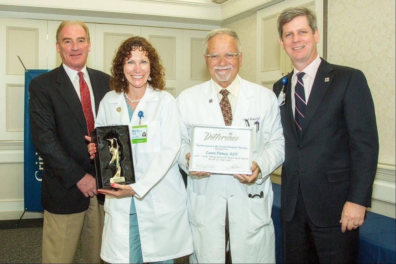 From left, Kim Sobinsky, MD, president of Northwestern Lake Forest Hospital medical staff; Laura Pamay, BSN, RN; Michael Ankin, MD, vice president, Medical Affairs and chief medical officer; and Thomas J. McAfee, president of Northwestern Lake Forest Hospital, as Pamay receives the 2013 Jean Ewing Nursing Excellence Award.