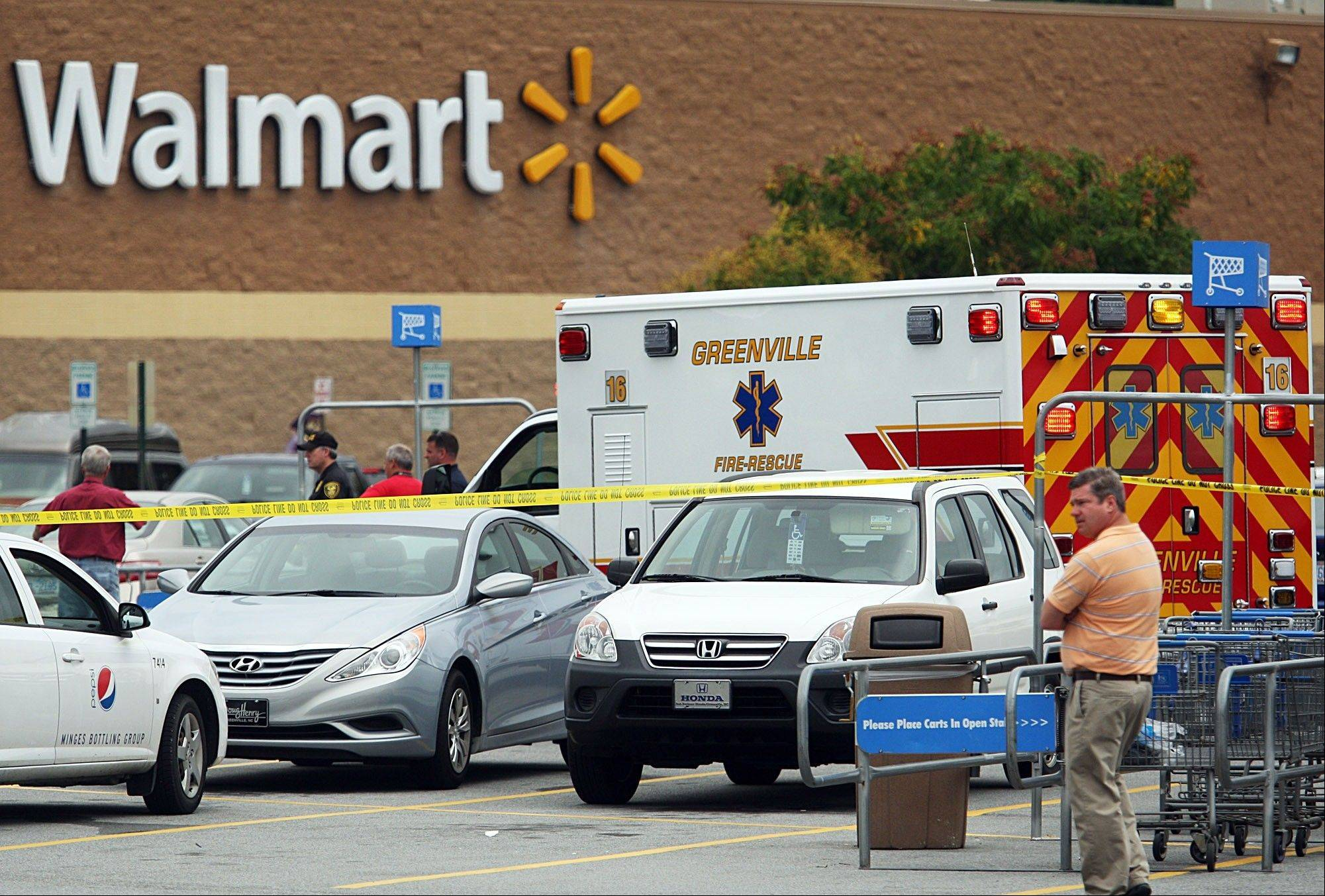 An ambulance sits Friday in the parking lot of a Wal-mart in Greenville, N.C.
