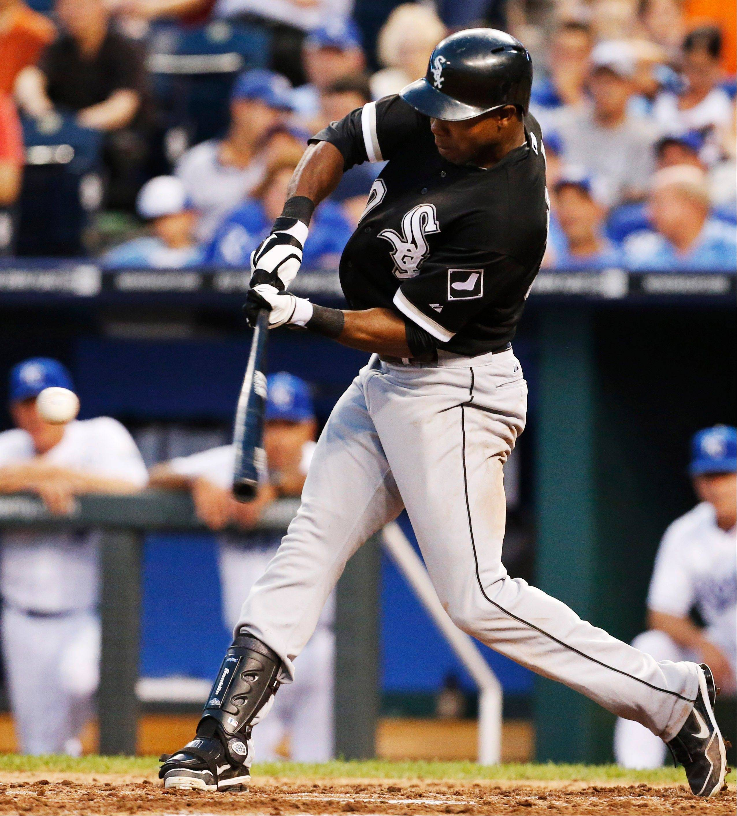 Chicago White Sox's Alejandro De Aza hits a two-run home run off Kansas City Royals relief pitcher Bruce Chen during the sixth inning of a baseball game at Kauffman Stadium in Kansas City, Mo., Friday, June 21, 2013. (AP Photo/Orlin Wagner)