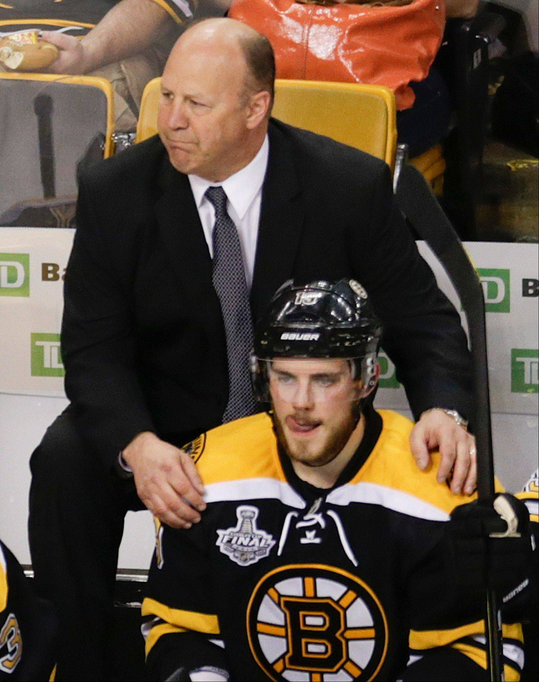 Bruins coach Claude Julien encourages center Tyler Seguin during the second period of Game 4 of the Stanley Cup Final against the Hawks on Wednesday in Boston.