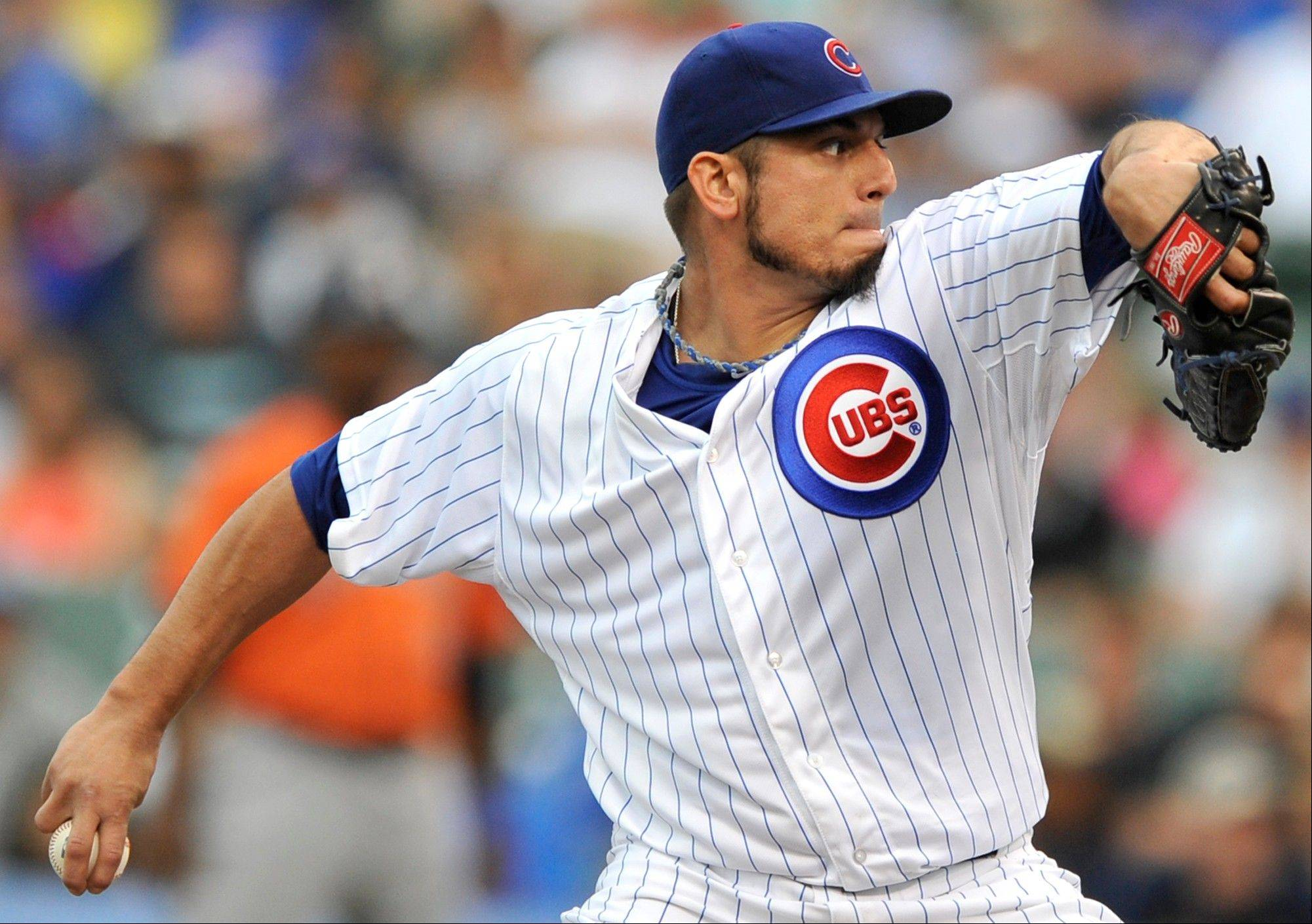Chicago Cubs starter Matt Garza delivers a pitch during the first inning of a baseball game against the Houston Astros in Chicago, Friday, June 21, 2013. (AP Photo/Paul Beaty)