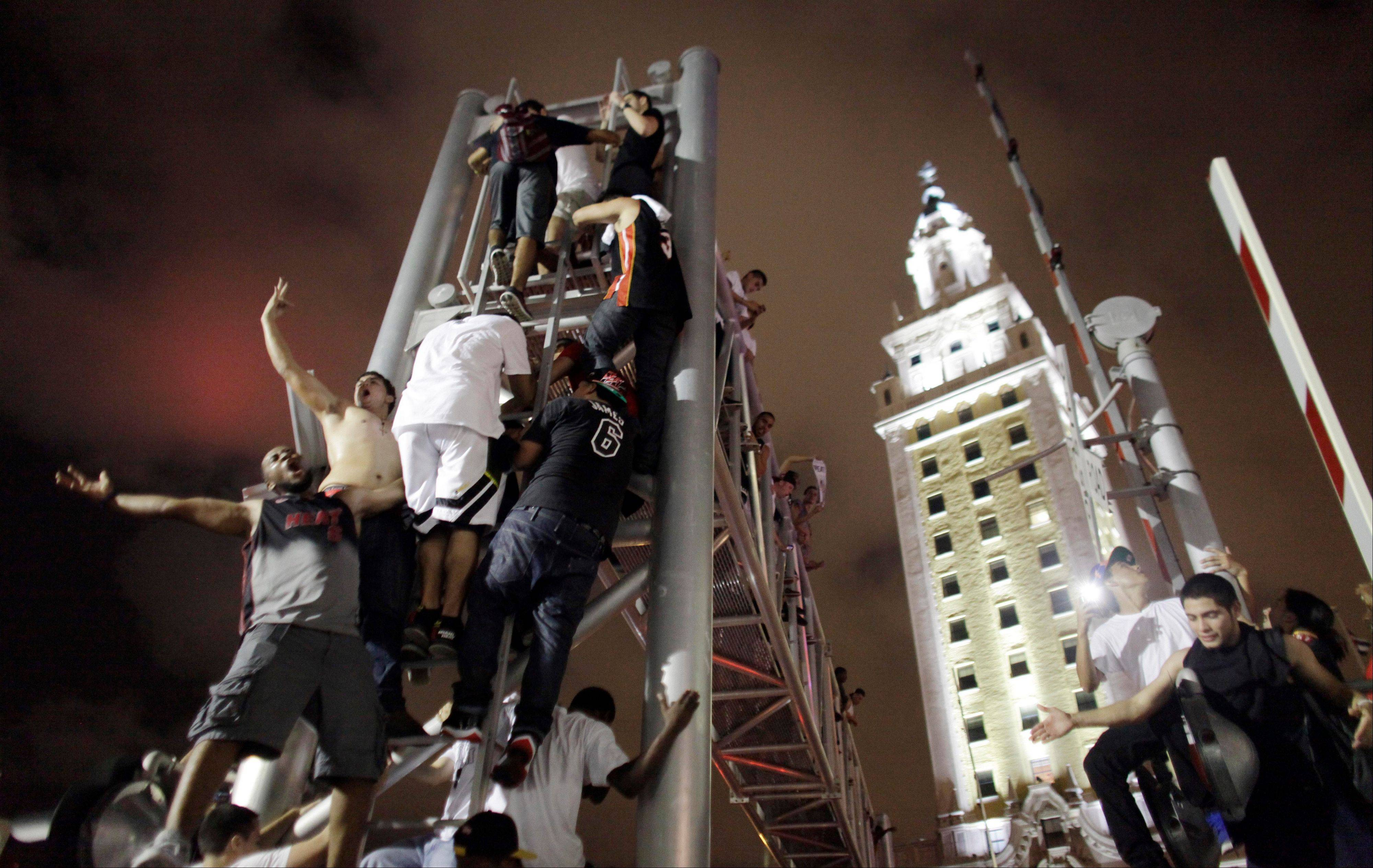 Miami celebrates Heat victory, Spurs fans somber