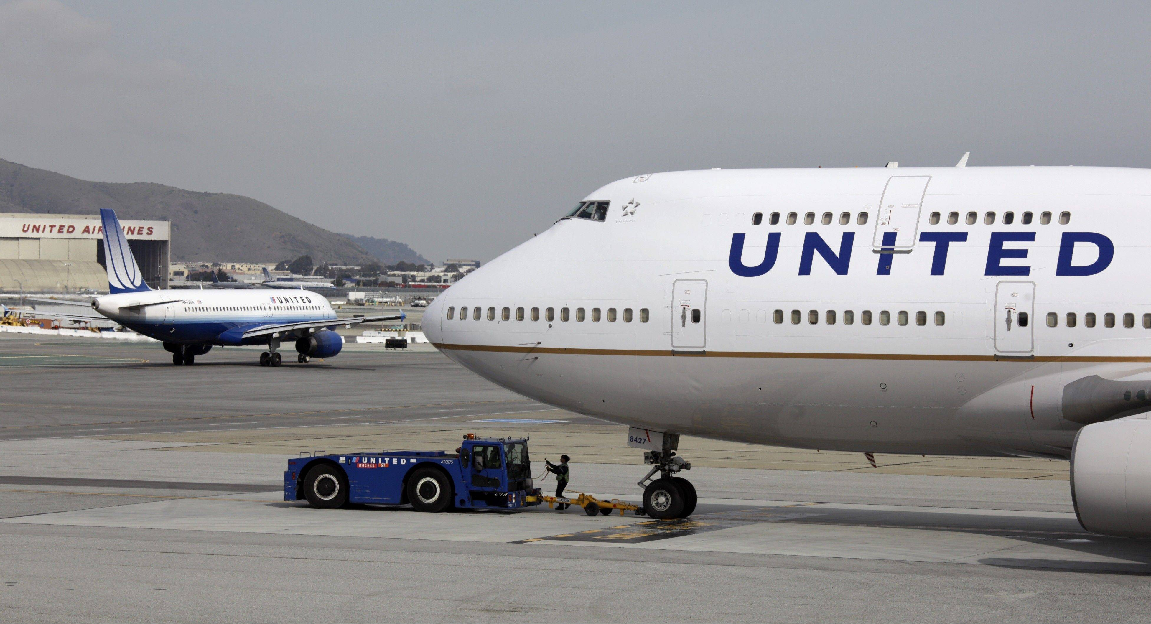 United Airlines planes taxi at San Francisco International Airport.
