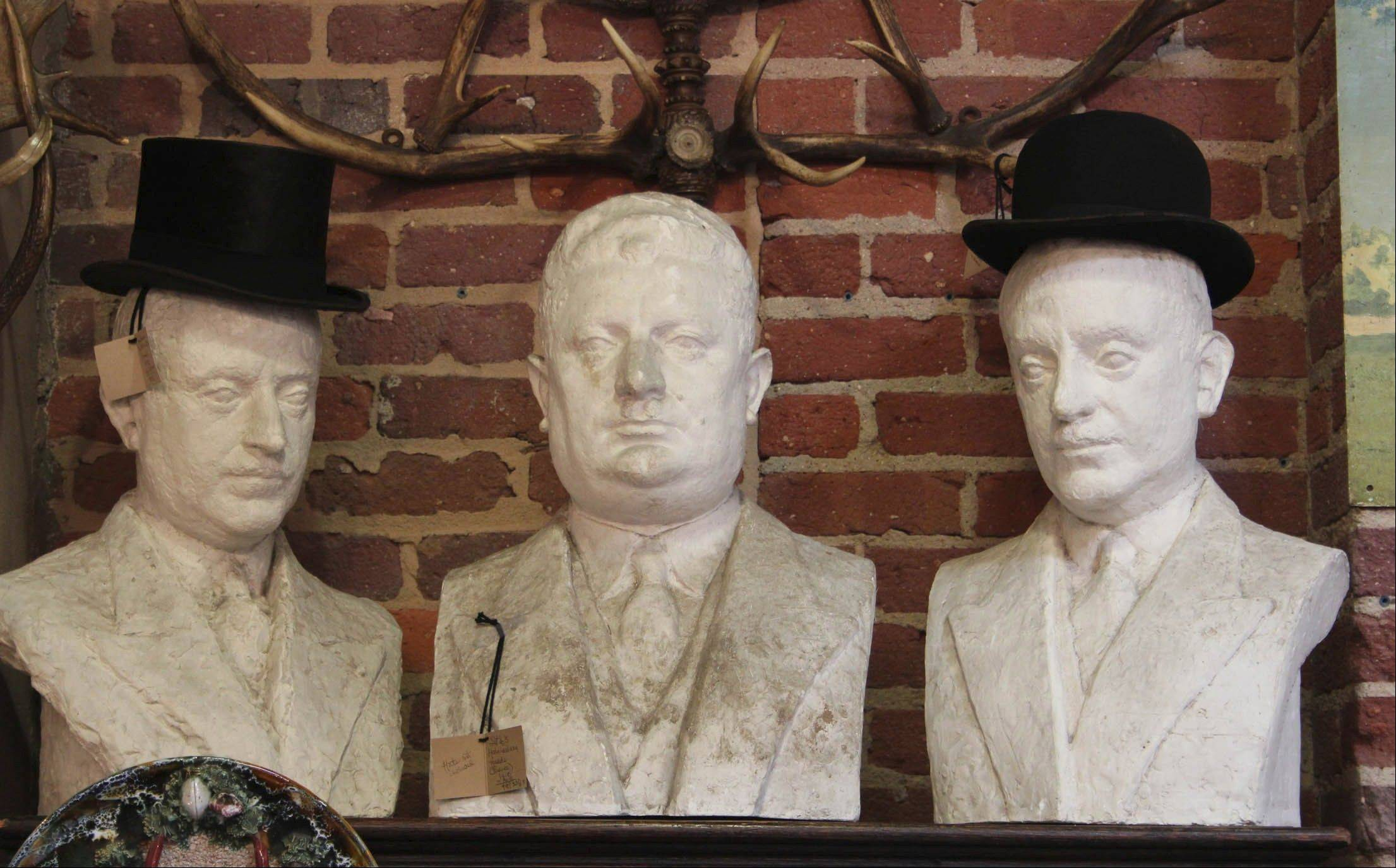 A set of three French haberdashery busts of heavy-duty plaster are from Added Oomph!, an accessories store in High Point, N.C.