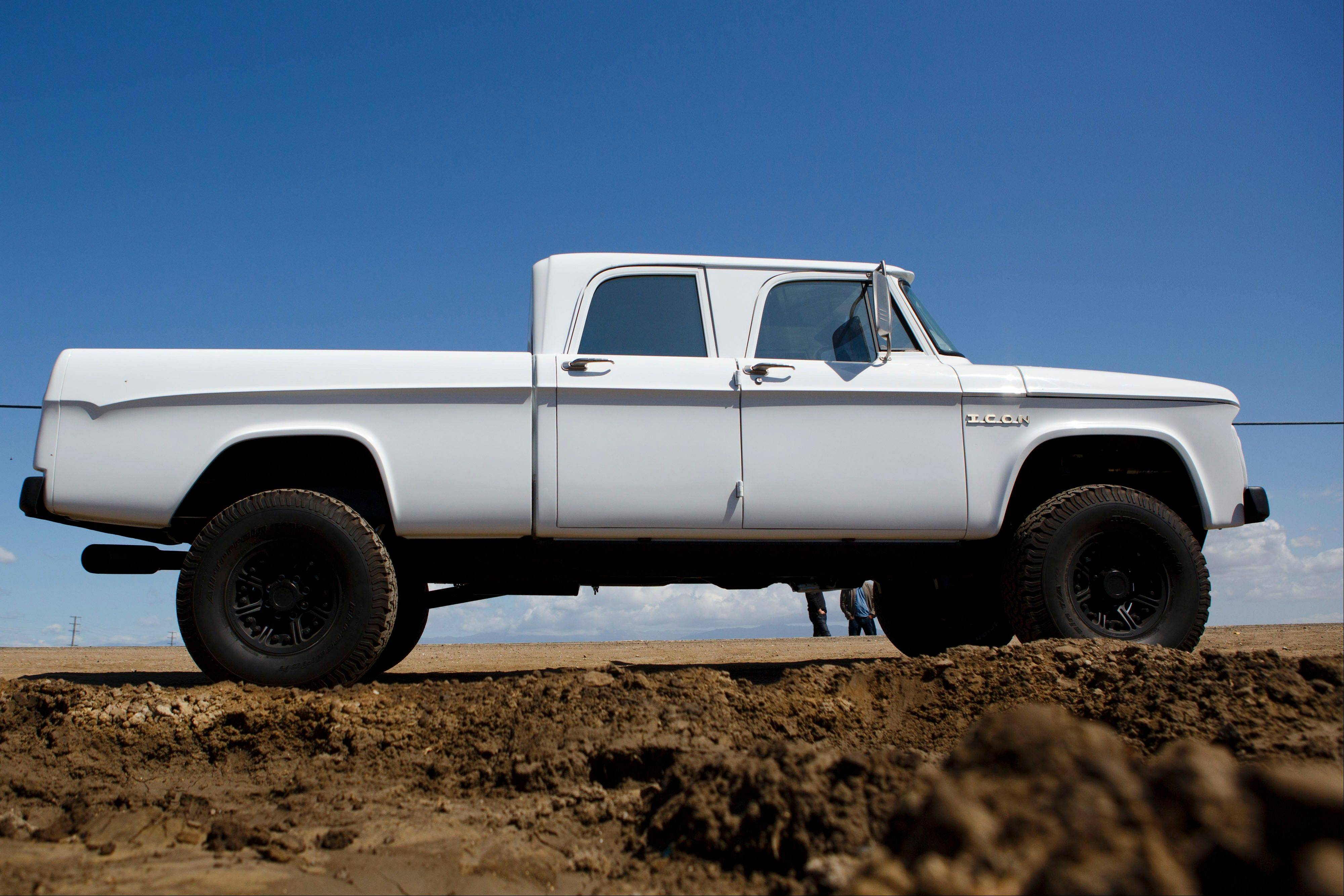 A custom 1965 Dodge D200 truck stands near Malibu, Calif. Jonathan Ward, owner and head designer of Los Angeles-based custom automobile maker Icon, and his crew spent a year on the Dodge.
