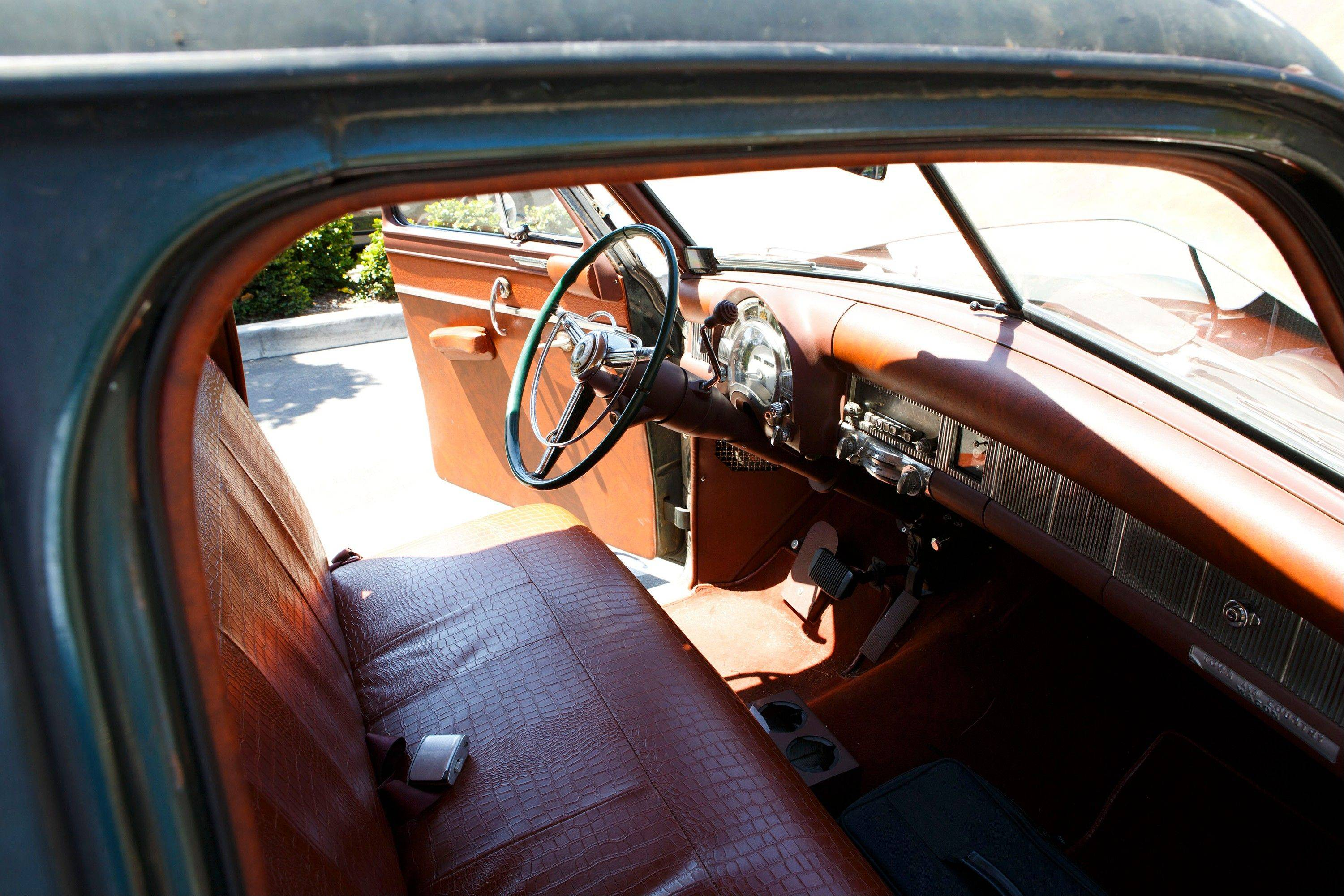 The original steering wheel and wood flooring of a 1952 Chrysler Town & Country wagon were used to create the custom vehicle with a front end off a DeSoto.