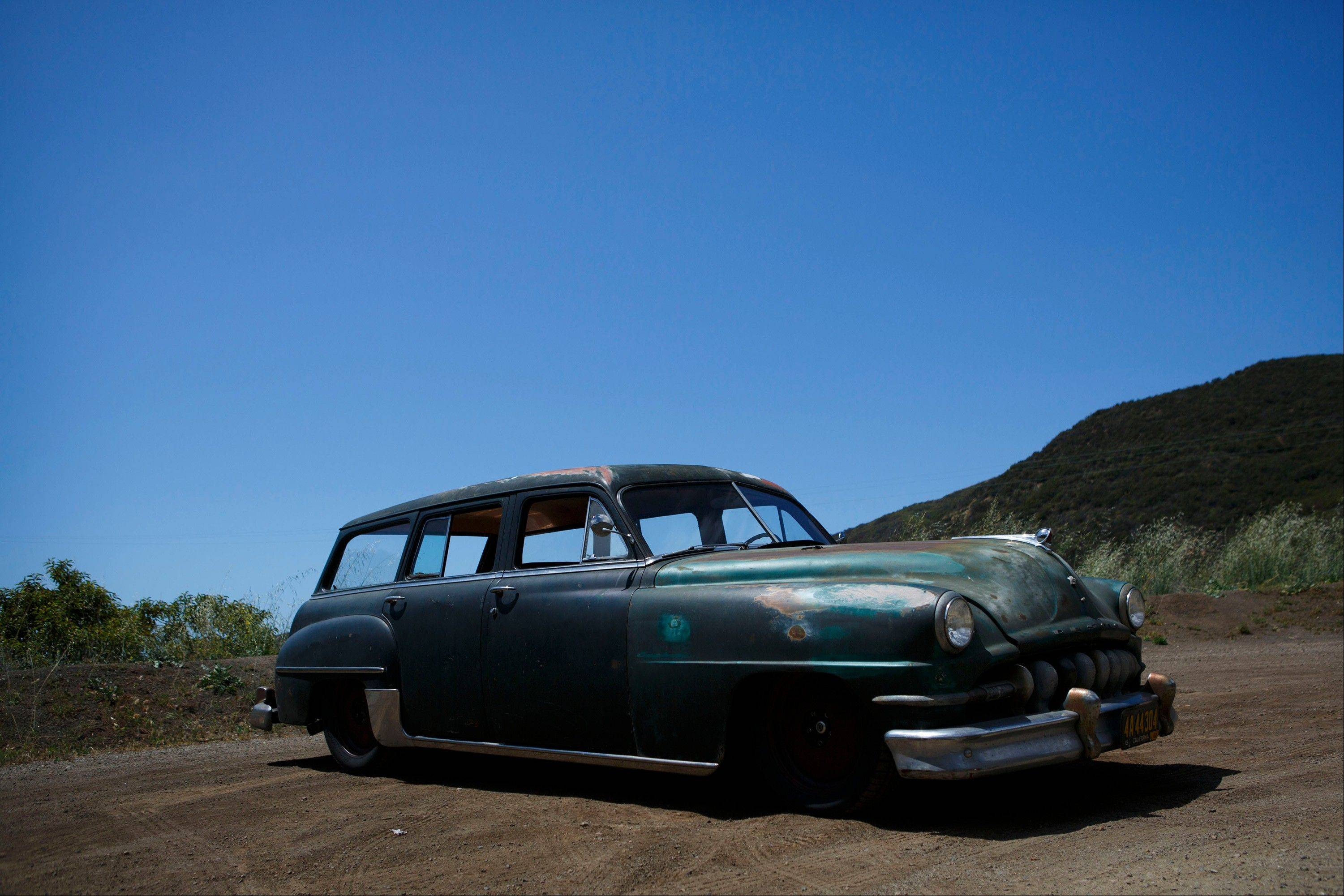 A 1952 Chrysler Town & Country Wagon, with the front end of a DeSoto, stands near Malibu, Calif.