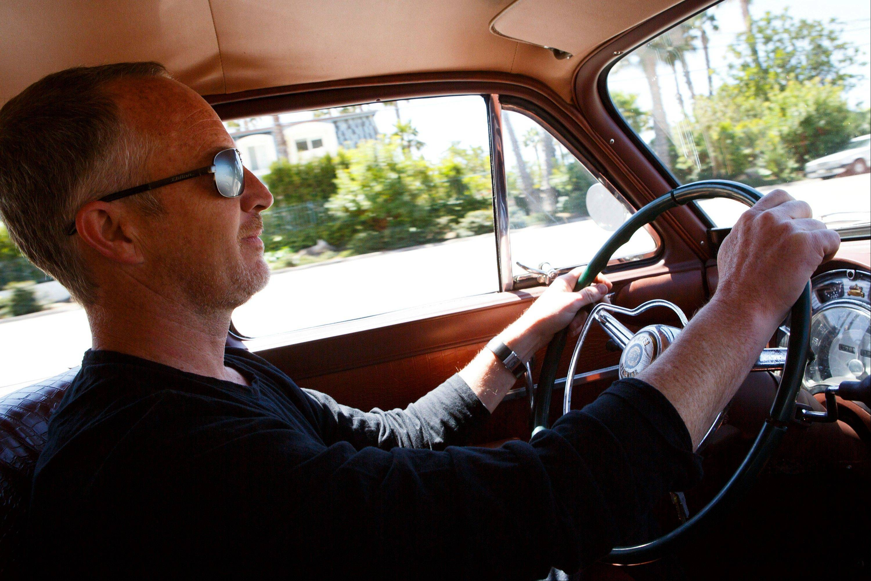 Jonathan Ward, owner and head designer of Los Angeles-based custom automobile maker Icon, sits behind the wheel of his 1952 Chrysler wagon, which he will re-create for $190,000.