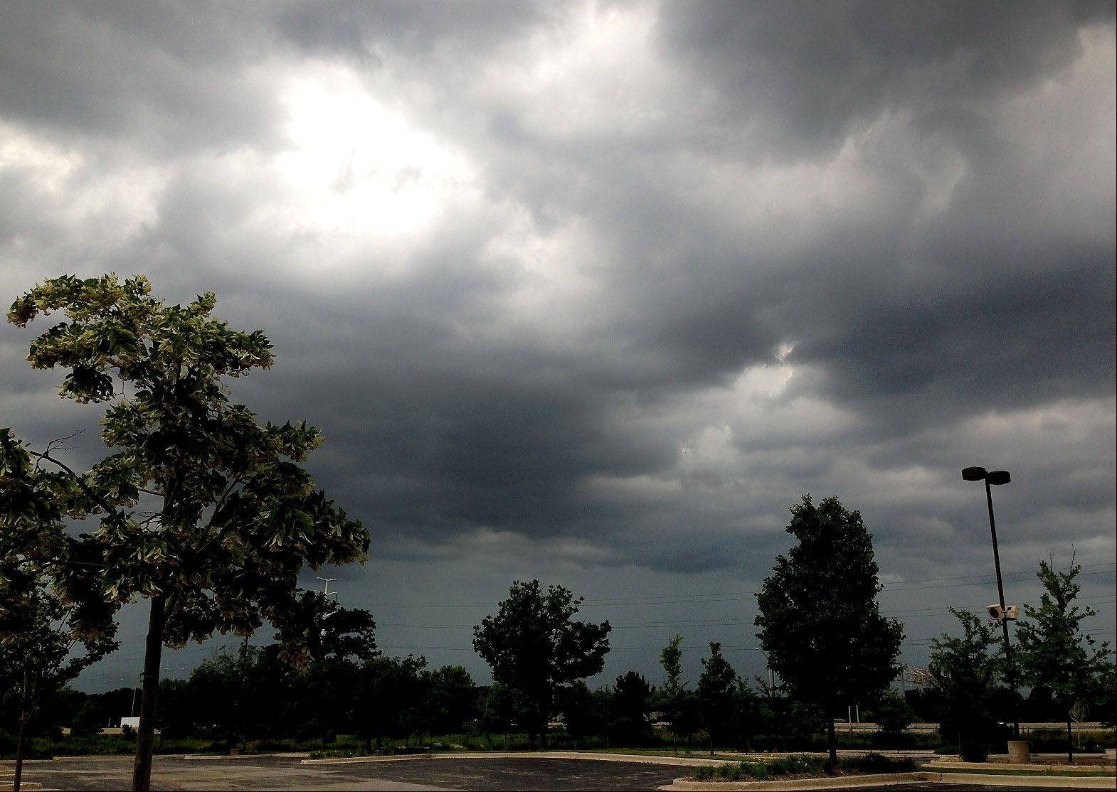 Clouds darken the skies over Warrenville on Friday.