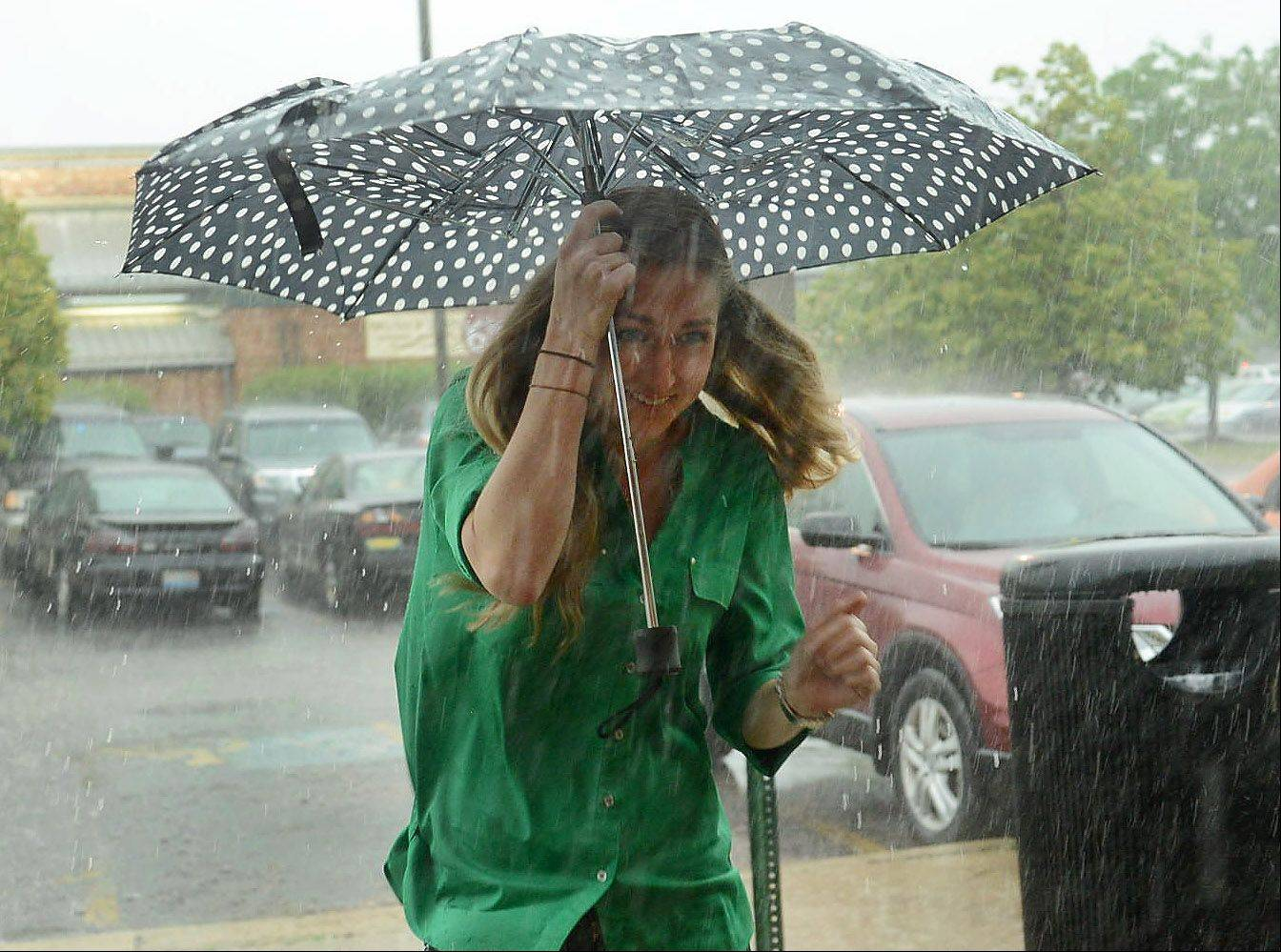 Cristina Lafevers of Bloomingdale flees Friday's storm by running into a Panera in Schaumburg.
