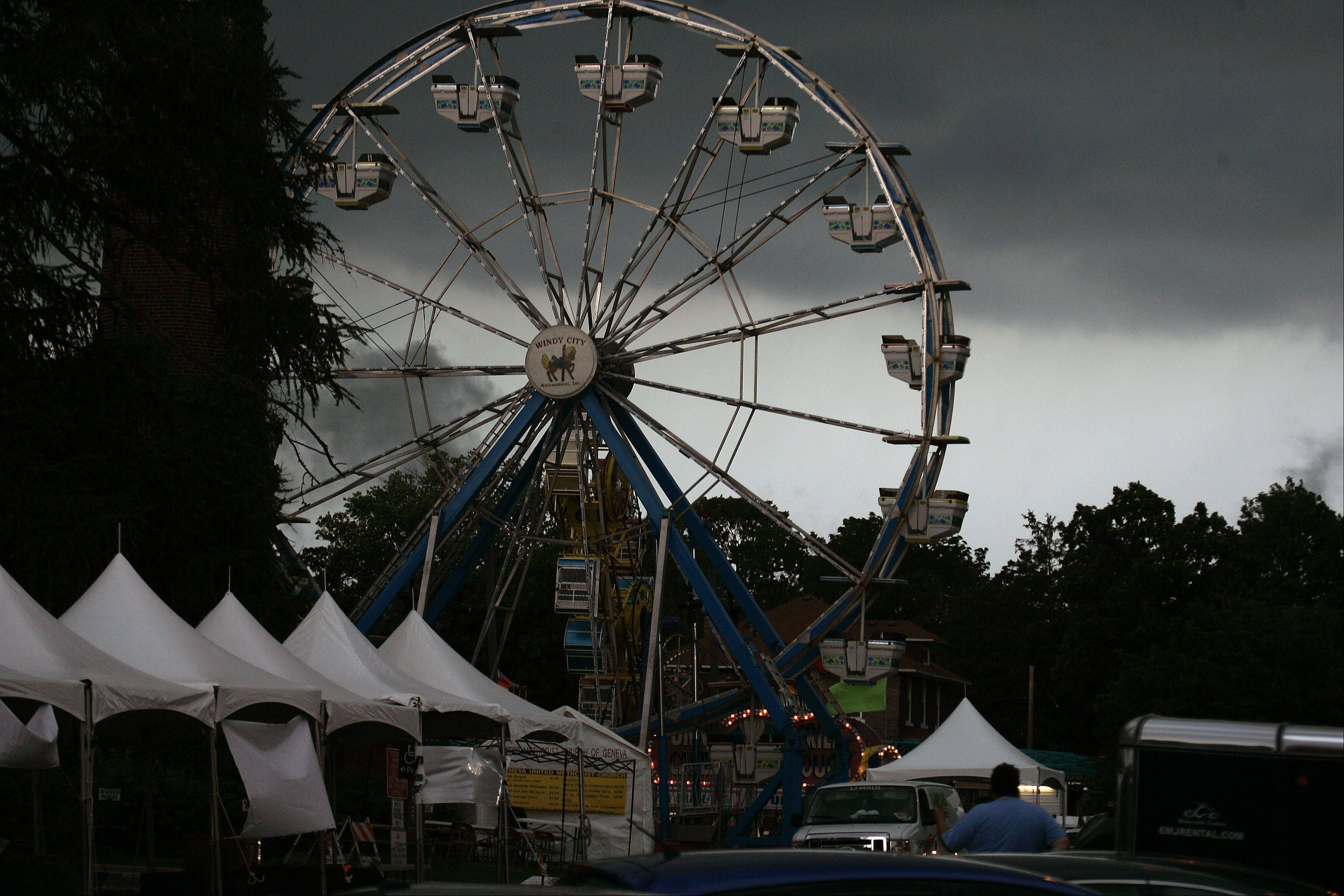 Storms roll into Geneva Friday causing the Swedish Days festival to be shut down temporarily.