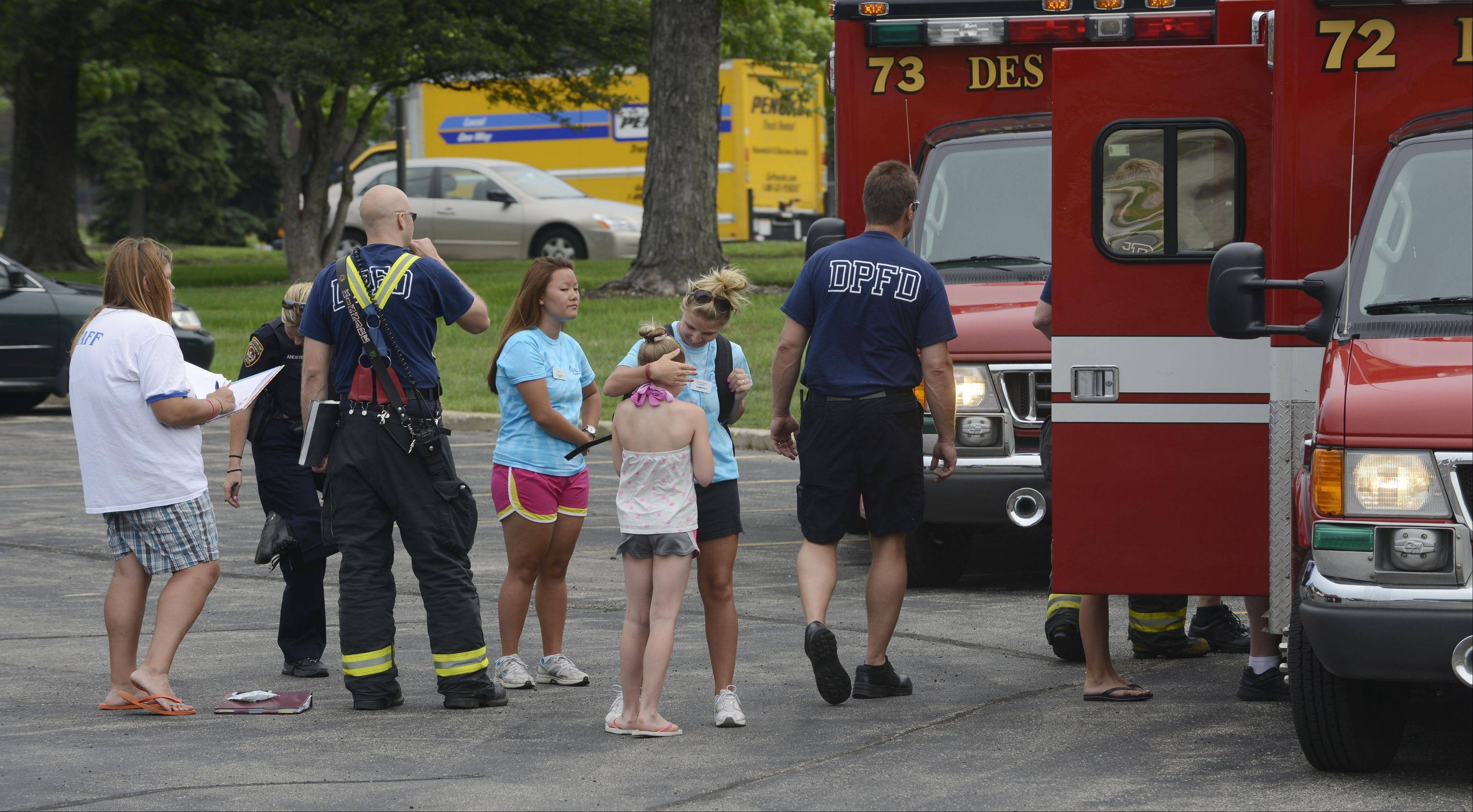 Firefighter paramedics assist children following an Friday morning accident involving two school buses that were carrying participants of a Des Plaines Park District program.