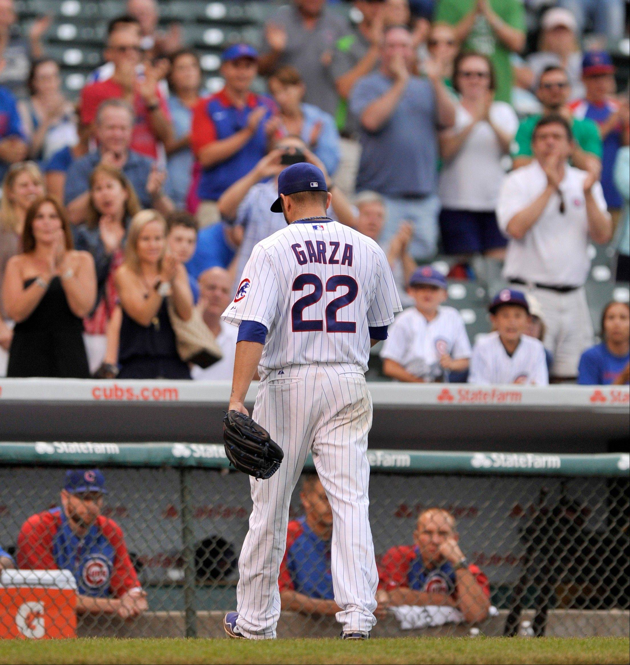 Matt Garza leaves during the ninth inning of a baseball game against the Houston Astros in Chicago, June 21, 2013. Chicago won 3-1.