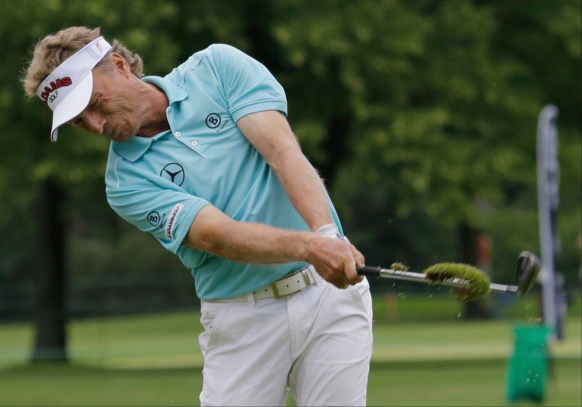 Bernhard Langer hits his second shot on the 18th fairway during the first round of the Encompass Championship golf tournament on Friday, June 21, 2013, in Glenview, Ill.