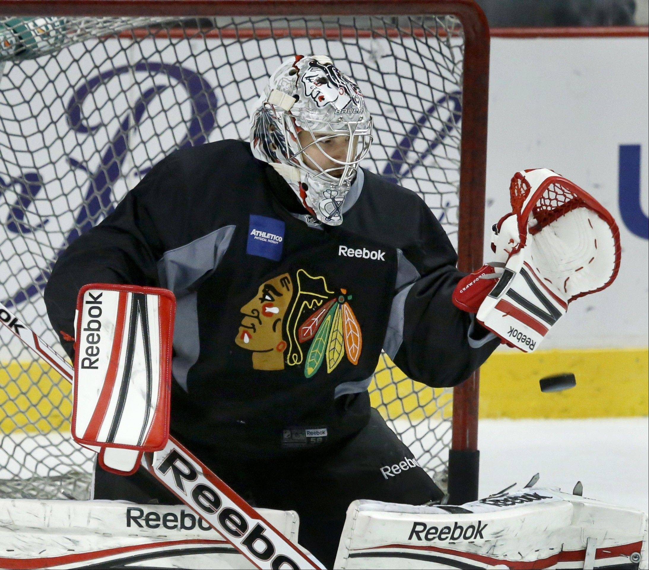 Chicago Blackhawks goalie Corey Crawford gets in some practice Friday in Chicago. The Blackhawks will host the Boston Bruins in Game 5 of the Stanley Cup Final series Saturday.