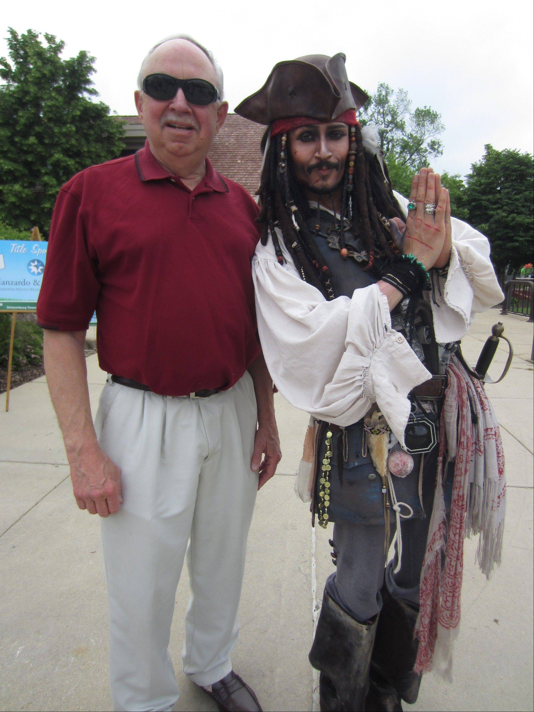 Schaumburg Mayor Al Larson and Capt. Jack Sparrow impersonator Rick Aspen greeted golfers during the School District 54 Foundation's 16th annual golf outing at Schaumburg Golf Club.
