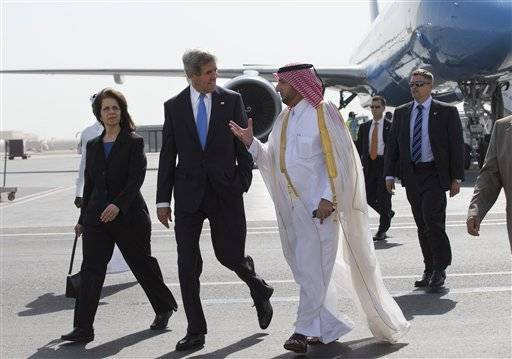 U.S. Ambassador to Qatar Susan Ziadeh, left, walks with U.S. Secretary of State John Kerry, second from left, and Ambassador Ibrahim Fakhroo, Qatari Chief of Protocol, on Kerry's arrival in Doha, Qatar, on Saturday, June 22, 2013. Kerry began the overseas trip plunging into two thorny foreign policy problems facing the Obama administration: unrelenting bloodshed in Syria and efforts to talk to the Taliban and find a political resolution to the war in Afghanistan.