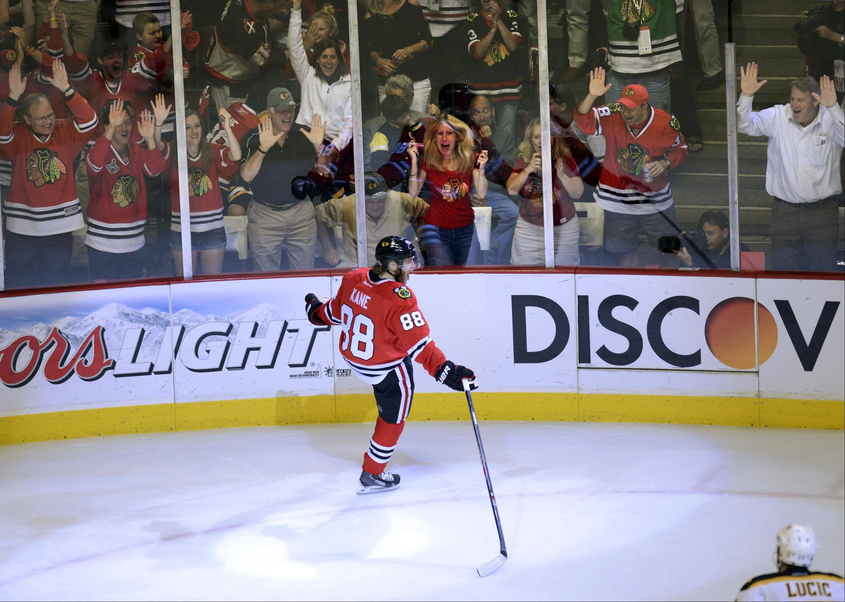 Chicago Blackhawks right wing Patrick Kane celebrates his first-period goal against the Boston Bruins Saturday in Game 5 of the Stanley Cup Finals at the United Center in Chicago.