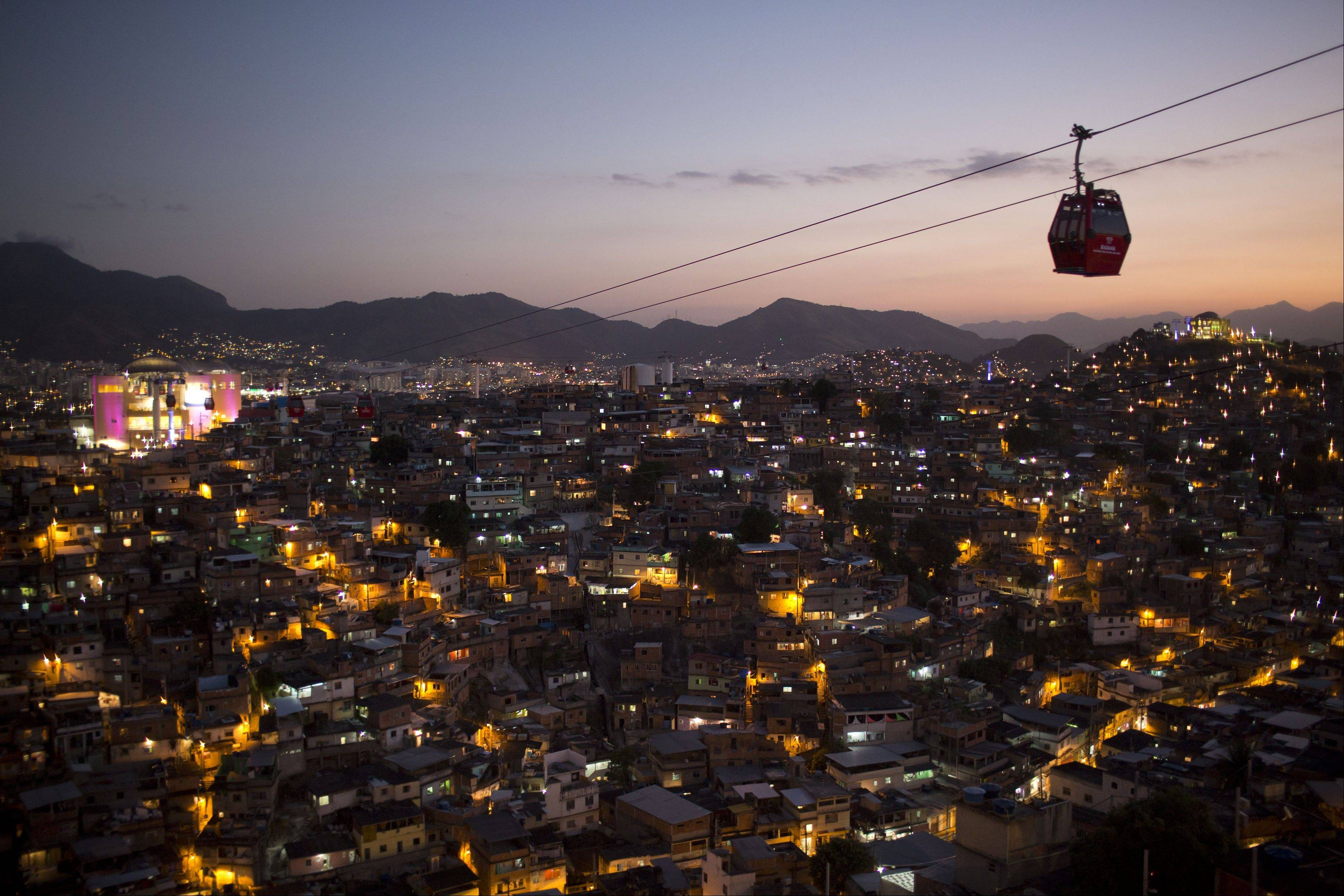 A cable-car system links six of its hilltops over the Complexo do Alemao shantytowns in Rio de Janeiro, Brazil.