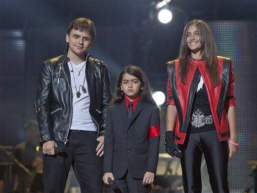 "Prince Jackson, left, Prince Michael II ""Blanket""Jackson and Paris Jackson arrive on stage at the Michael Forever the Tribute Concert, at the Millenni"
