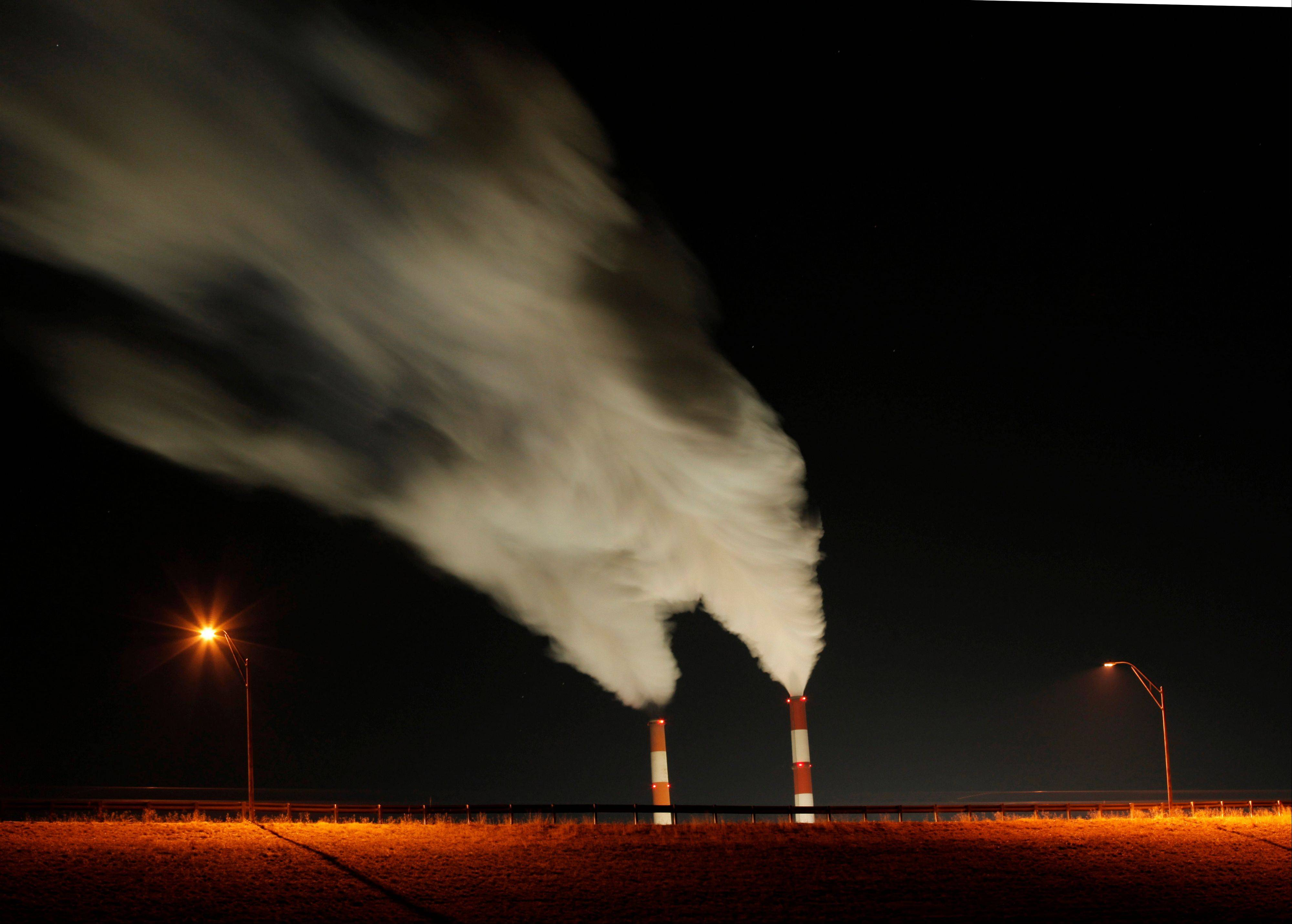 Time exposure image smoke rises from the stacks of the La Cygne Generating Station coal-fired power plant in La Cygne, Kan.
