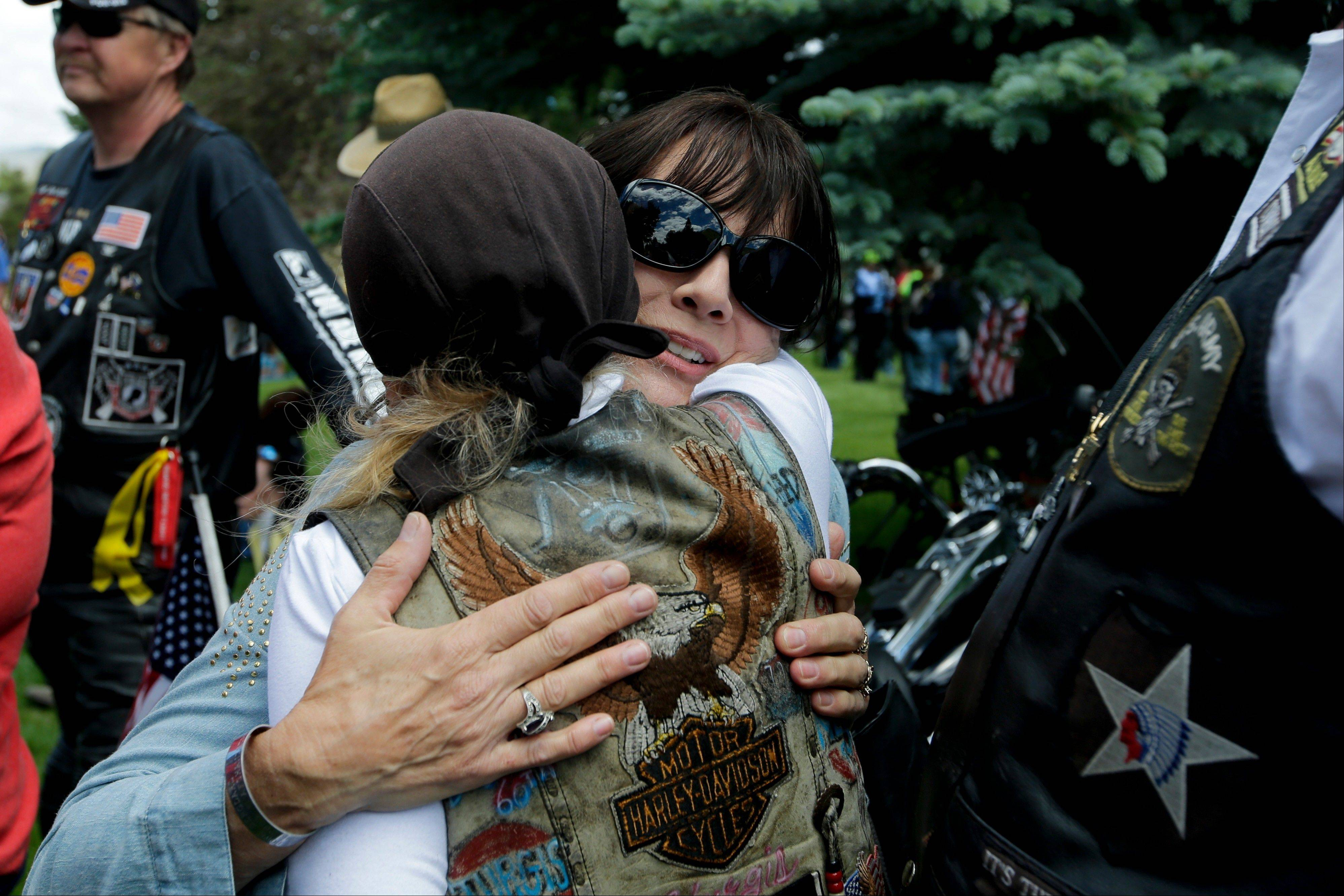 "Jani Bergdahl, center, mother of captive U.S. Army Sgt. Bowe Bergdahl, gets a hug Saturday from a well-wisher at the ""Bring Bowe Back"" celebration held to honor Sgt. Bergdahl in Hailey, Idaho."