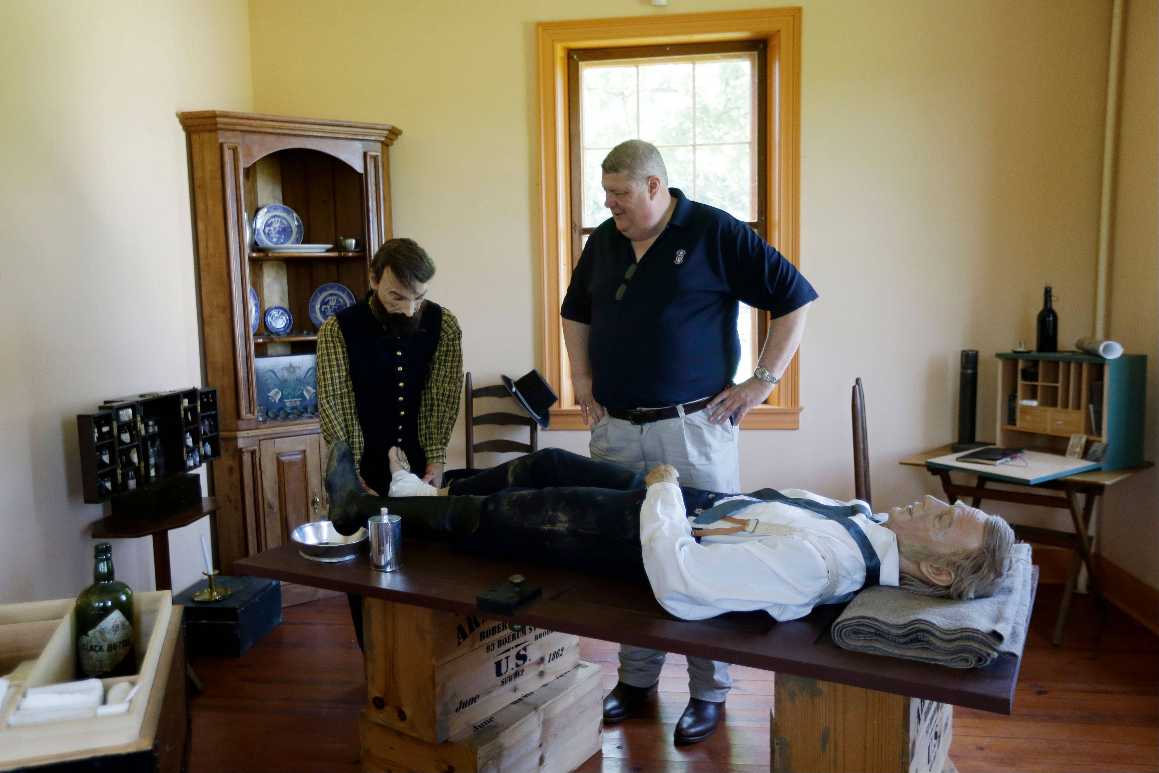 George Wunderlich, director of the National Museum of Civil War Medicine, poses for a portrait Friday with a depiction of an operating theater in the Pry House Field Hospital Museum in Keedysville, MD. The house is located on the Antietam Battlefield, which served both as Union General George McClellan's and Union Army Maj. Dr. Jonathan Letterman's headquarters during the battle.