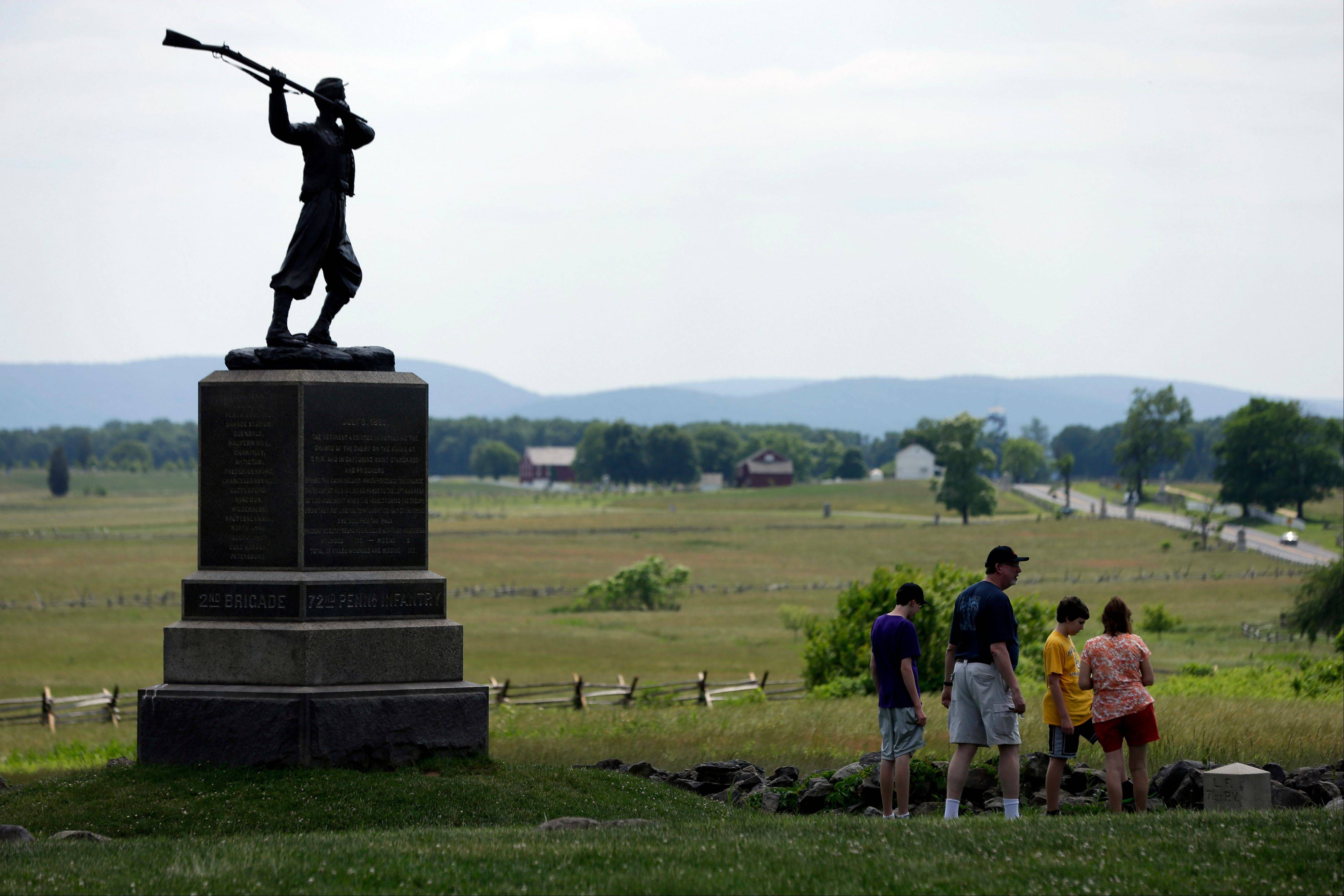 A monument sits atop a ridge held by Union troops, above the field of Pickett's Charge, in Gettysburg, Pa.