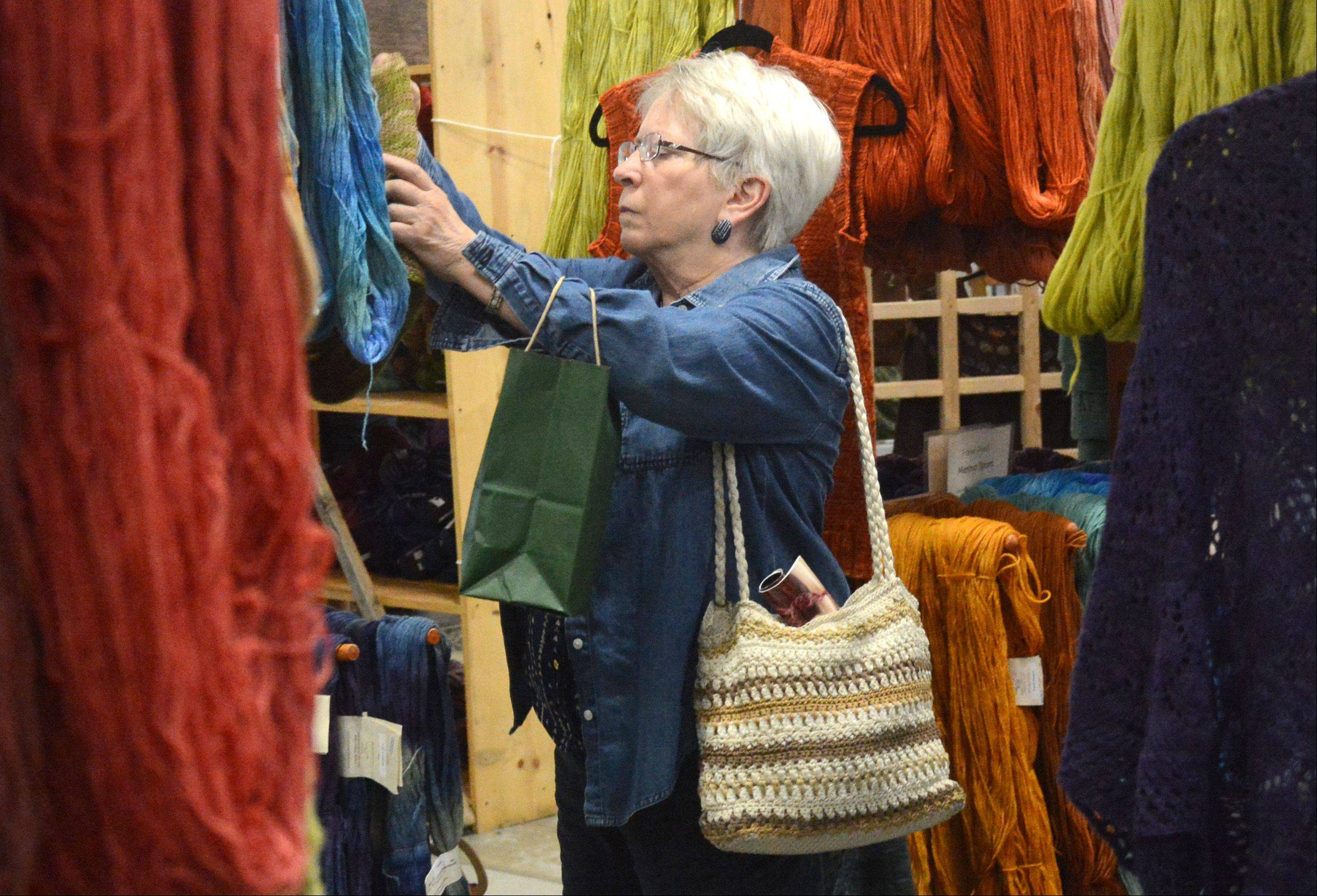 Barbara Lies of Madison, Wis., looks through rows of yarn.
