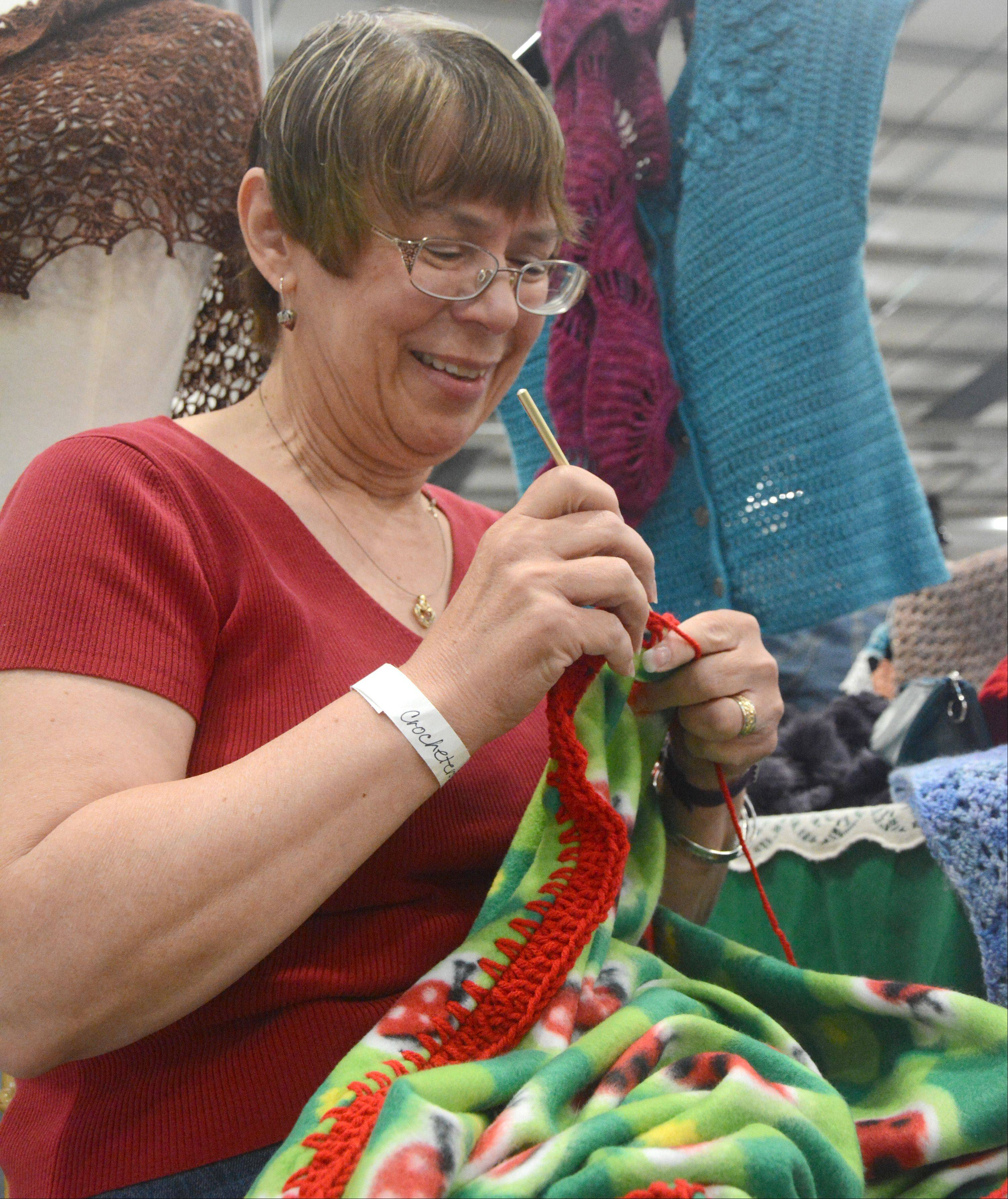 Karen Edgecombe of Lakemoor, a member of Crocheters of the Lakes, makes a blanket for Project Linus, which provides blankets for critically ill children.