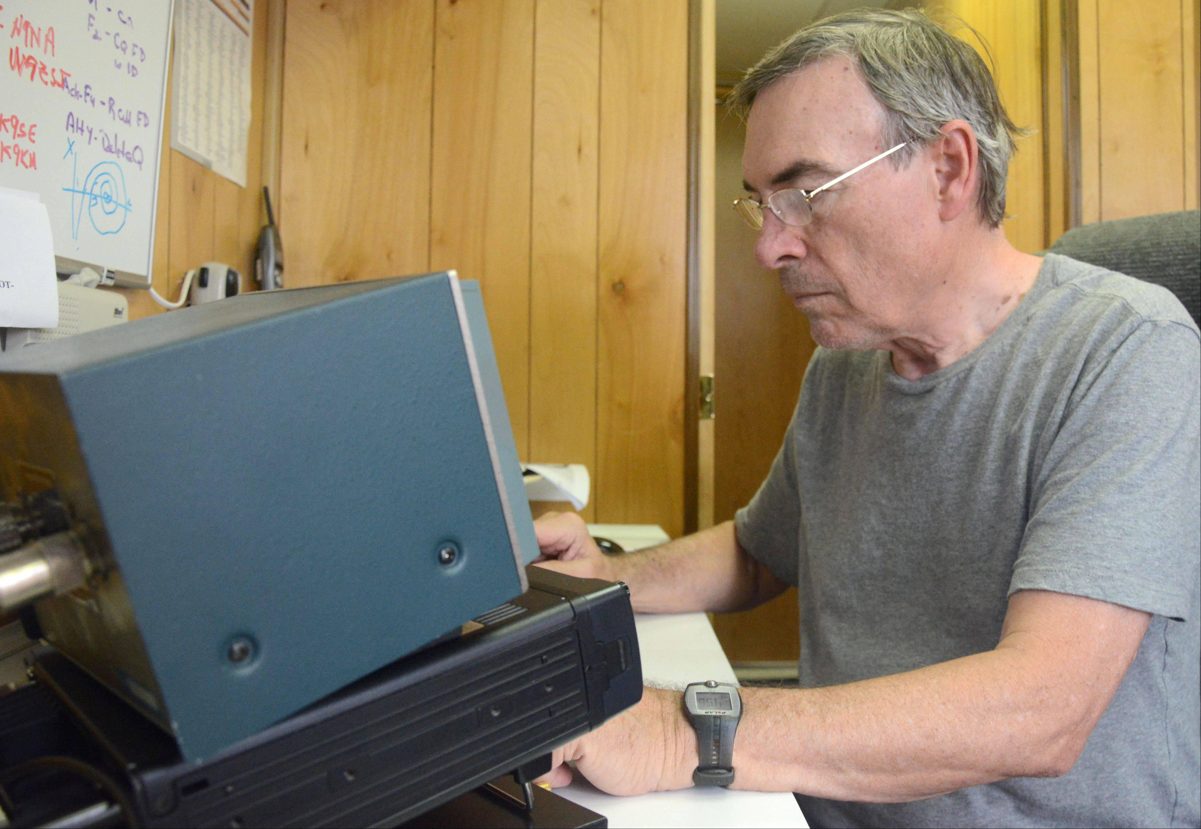 John Siepmann of Buffalo Grove tried to contact other amateur radio enthusiasts via an HF radio using morse code.