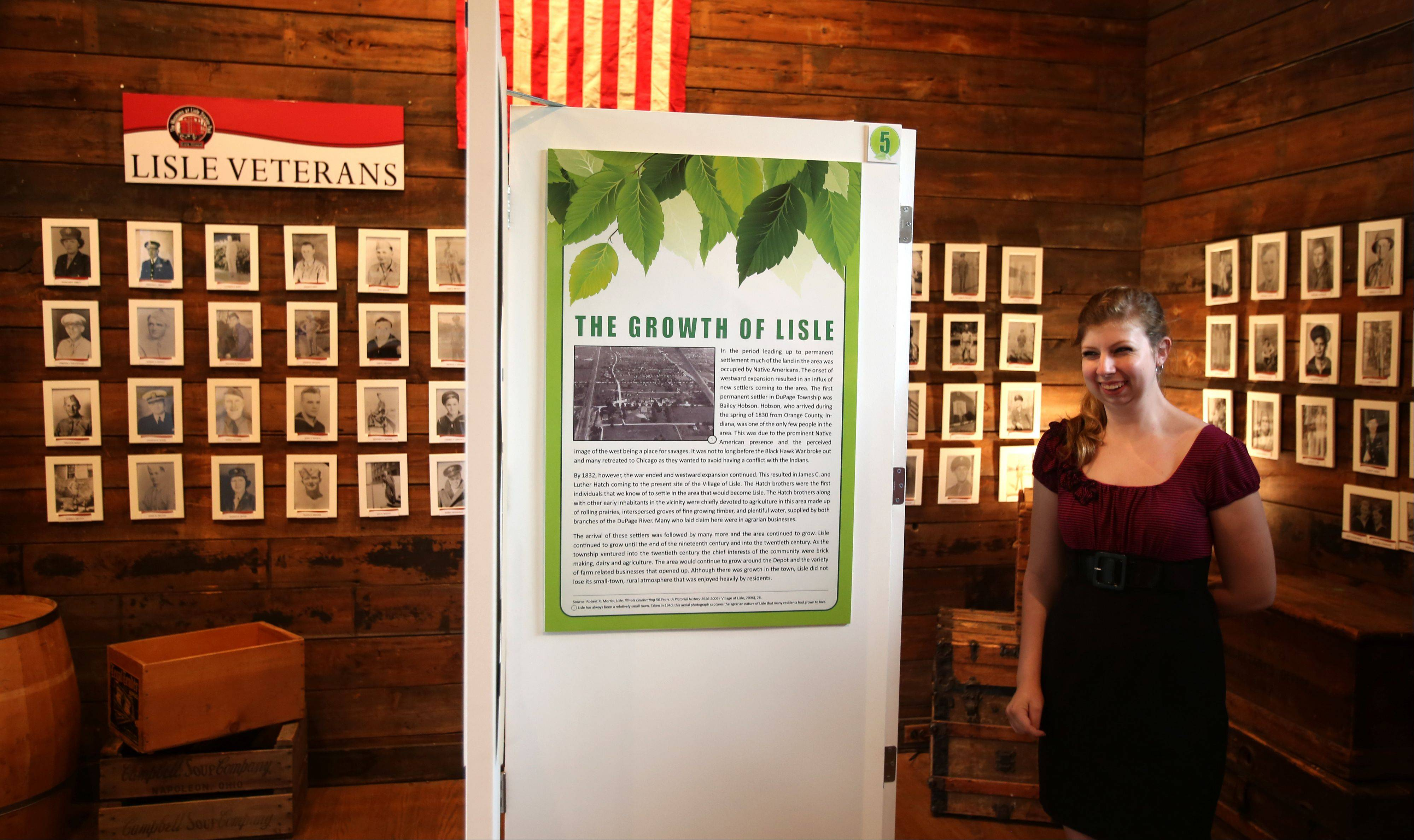 "Jackie Niemeyer looks over a new exhibit, ""Sustaining Lisle's Heritage: The Story of Lisle's Incorporation,"" which opened Saturday at the Depot Museum at Lisle Station Park. The exhibit is open through Oct. 5."