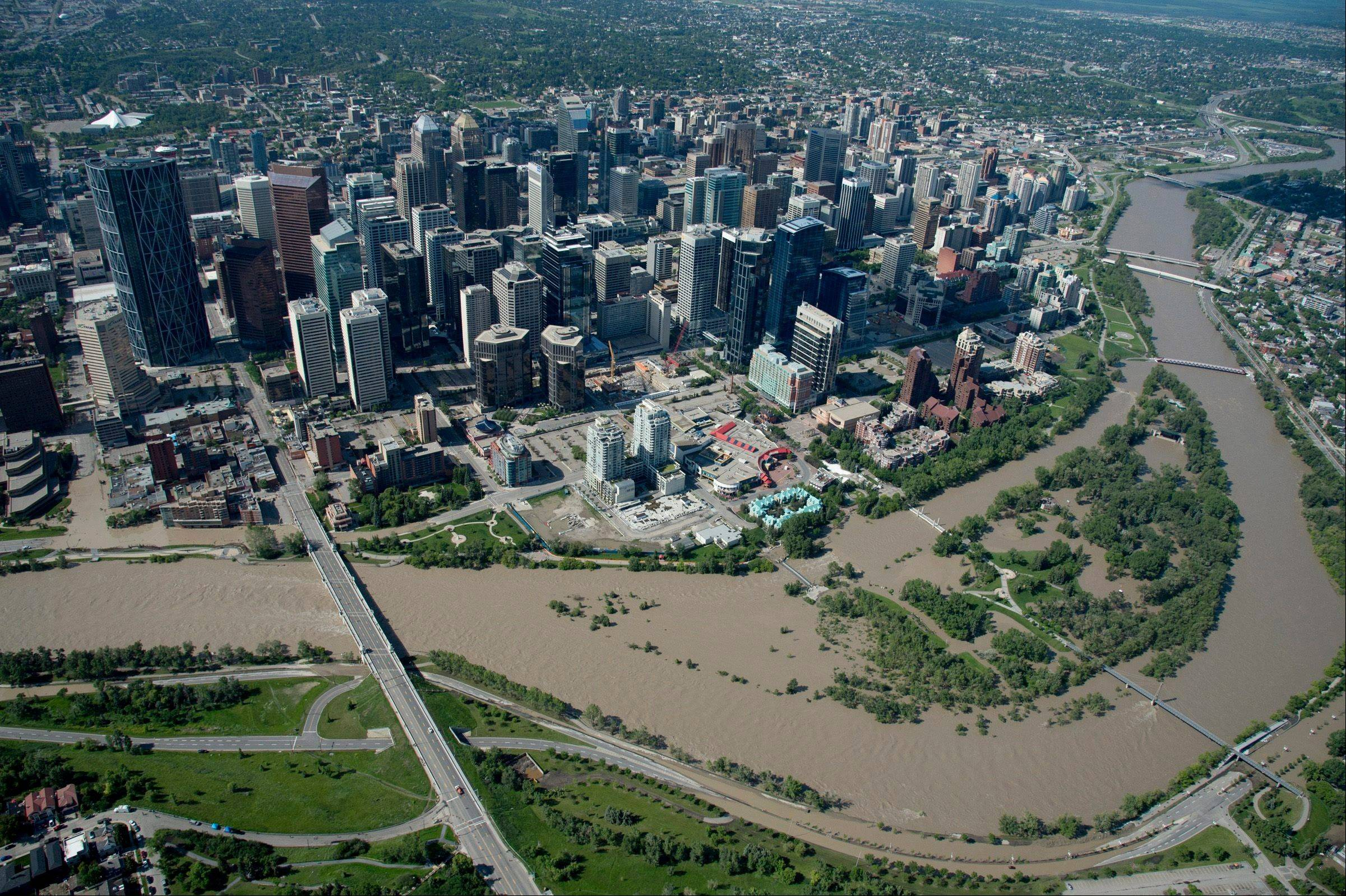This aerial photo taken Saturday shows downtown Calgary, Alberta. The two rivers that converge on Calgary are starting to recede after floods devastated much of the southern Alberta province, causing at least three deaths and forcing thousands to evacuate.