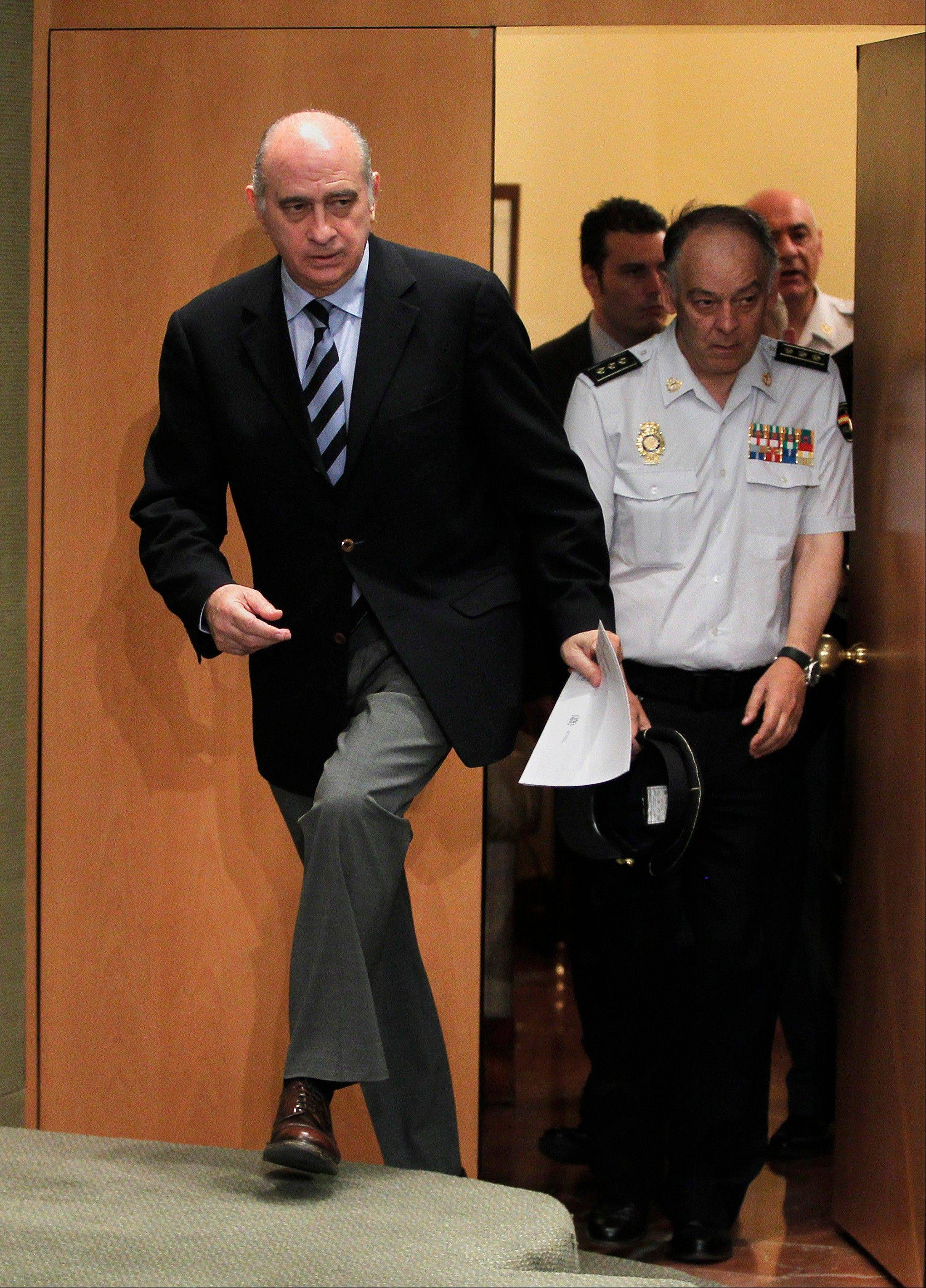 Spain's Interior Minister Jorge Fernandez Diaz, left, arrives at a news conference Saturday in Madrid.
