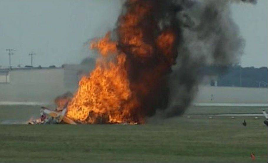 The stunt plane exploded on impact Saturday at the Vectren Air Show near Dayton, Ohio.