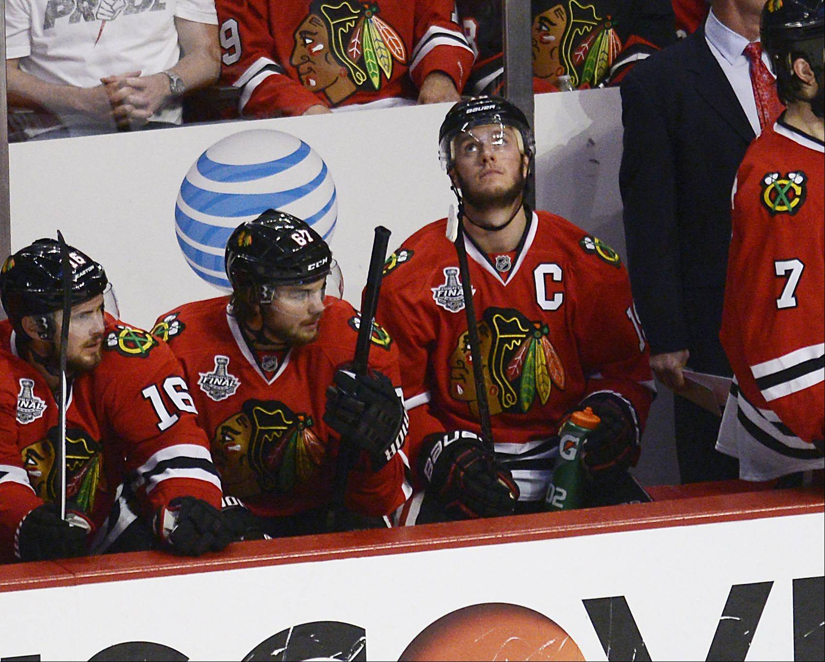 John Starks/jstarks@dailyherald.comChicago Blackhawks center Jonathan Toews watches the video board from the bench late in the third period Saturday in Game 5 of the Stanley Cup Finals at the United Center in Chicago.