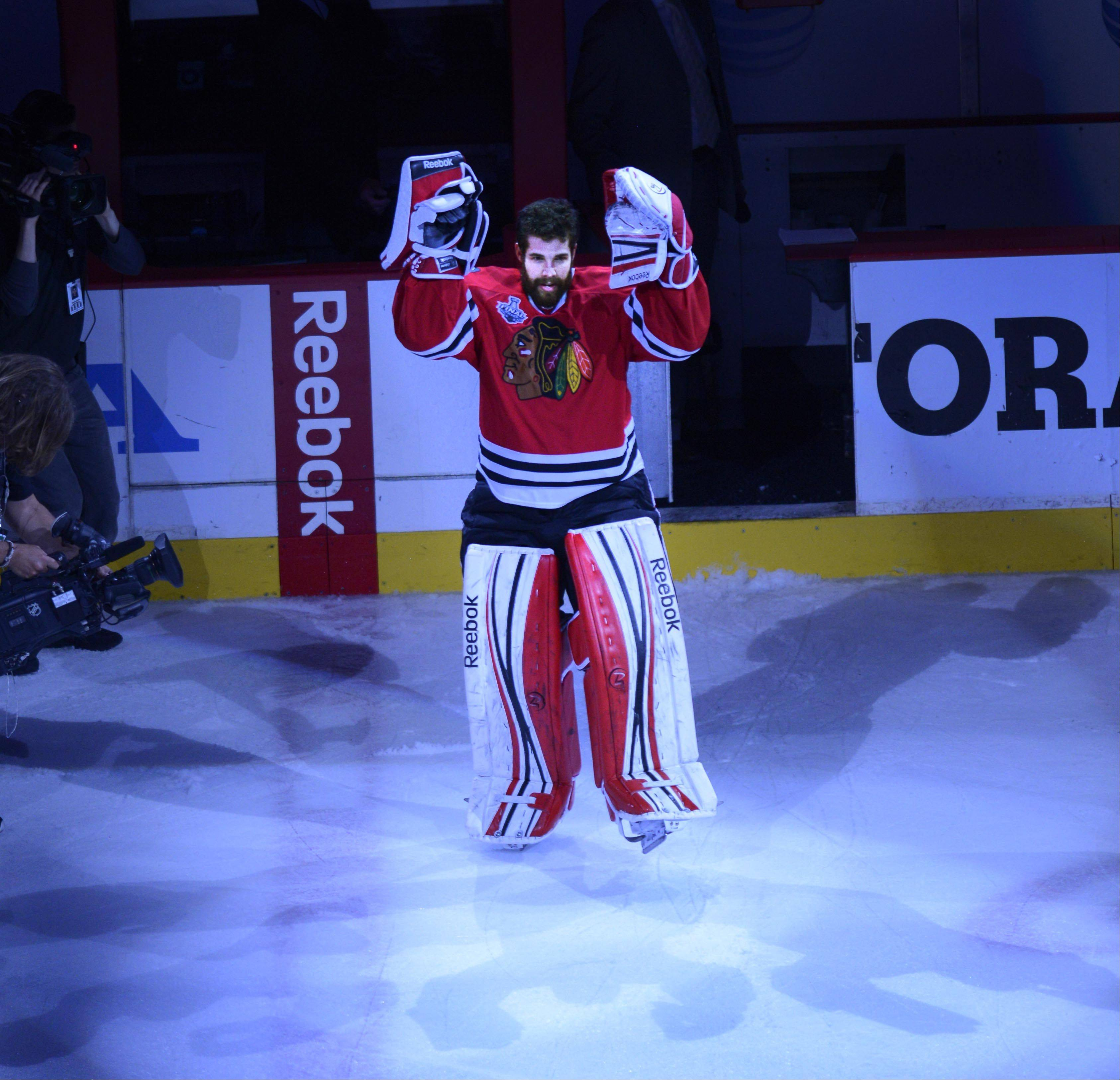 Blackhawks goalie Corey Crawford acknowledges the United Center crowd Saturday after being named one of the three stars of Game 5 of the Stanley Cup Final.