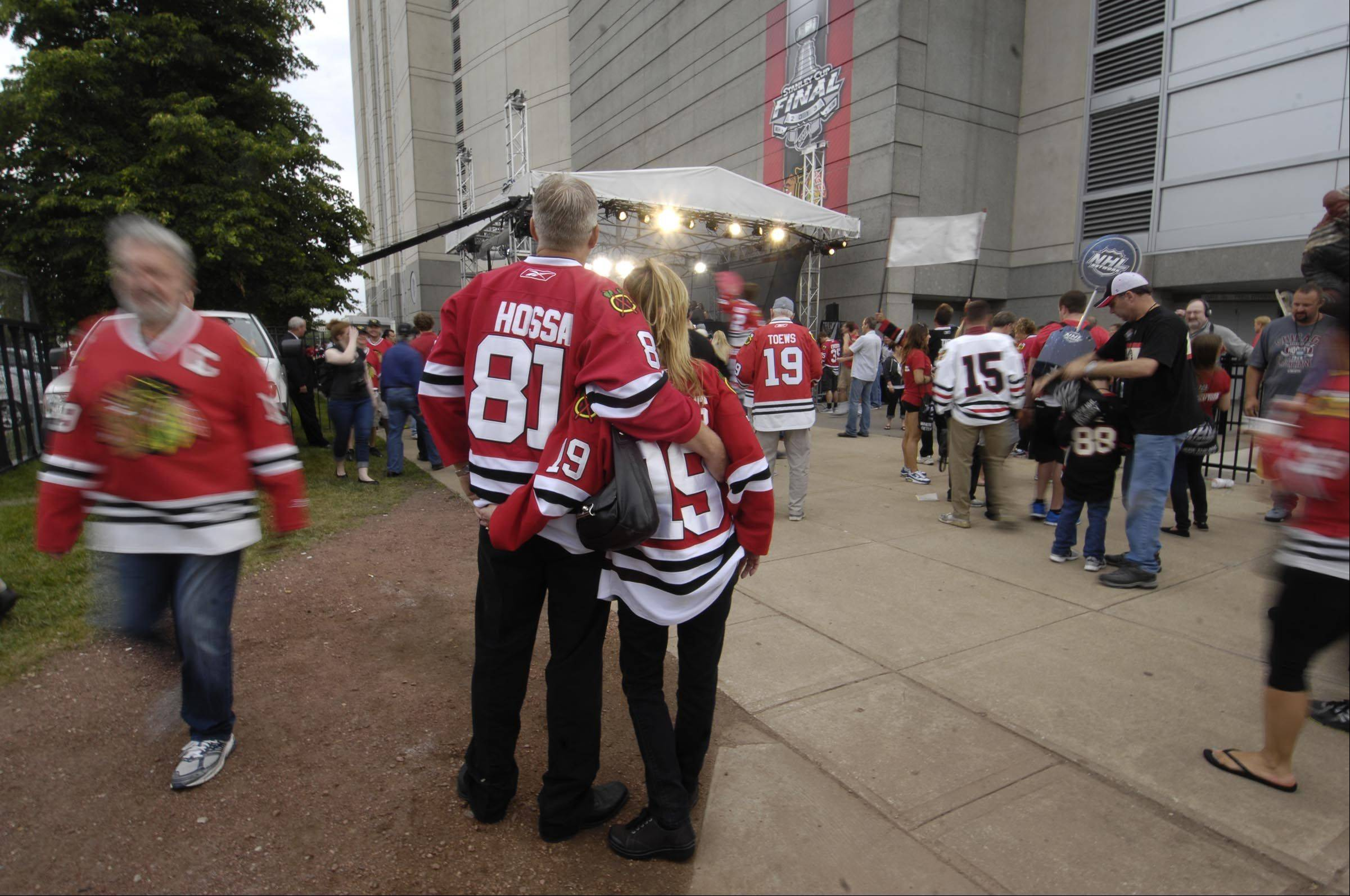 Rosie Woods and Pete Zaagman of Plainfield stand outside the United Center Saturday before Game 5 of the Stanley Cup Finals in Chicago.